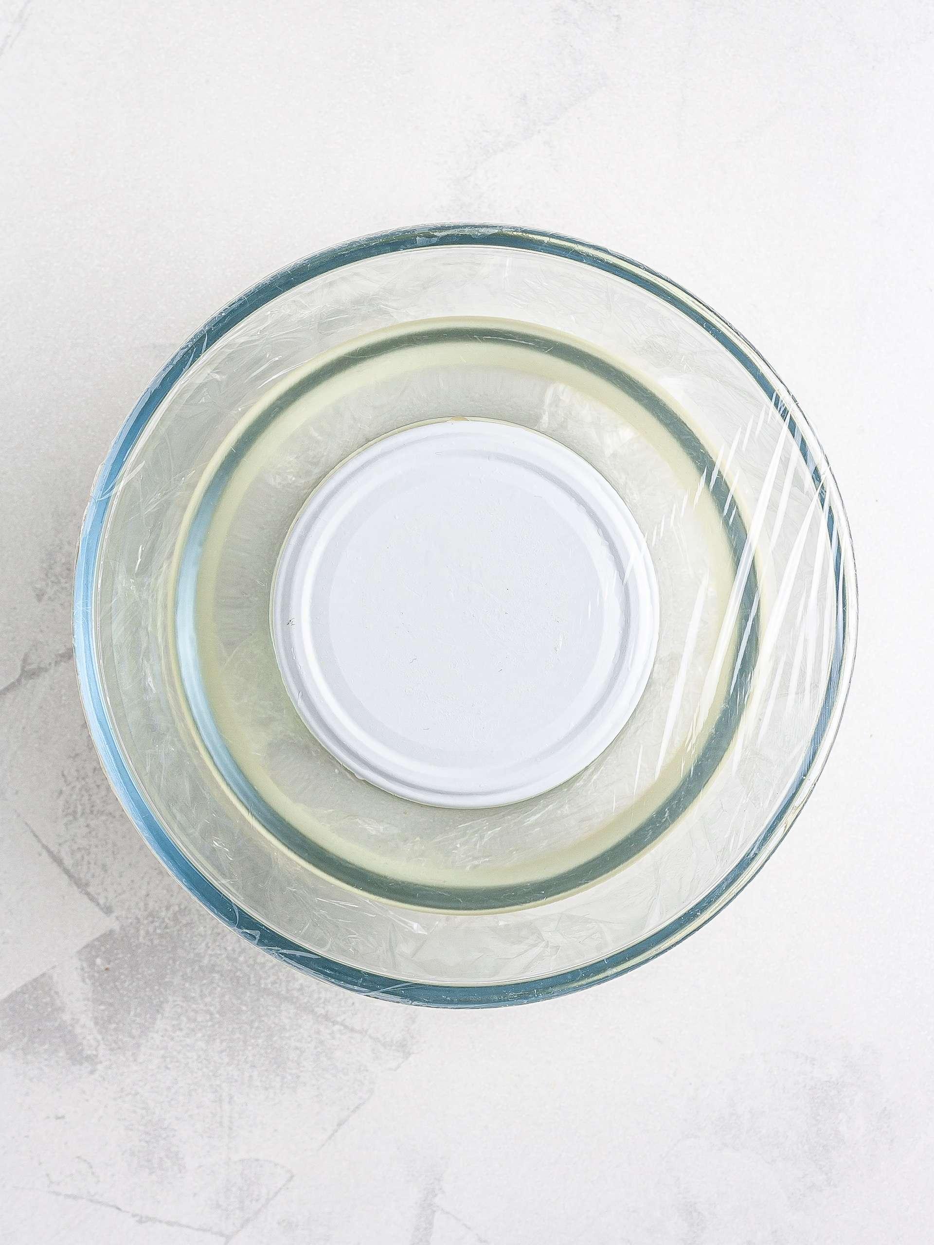 Oat milk yogurt incubated in a water bath