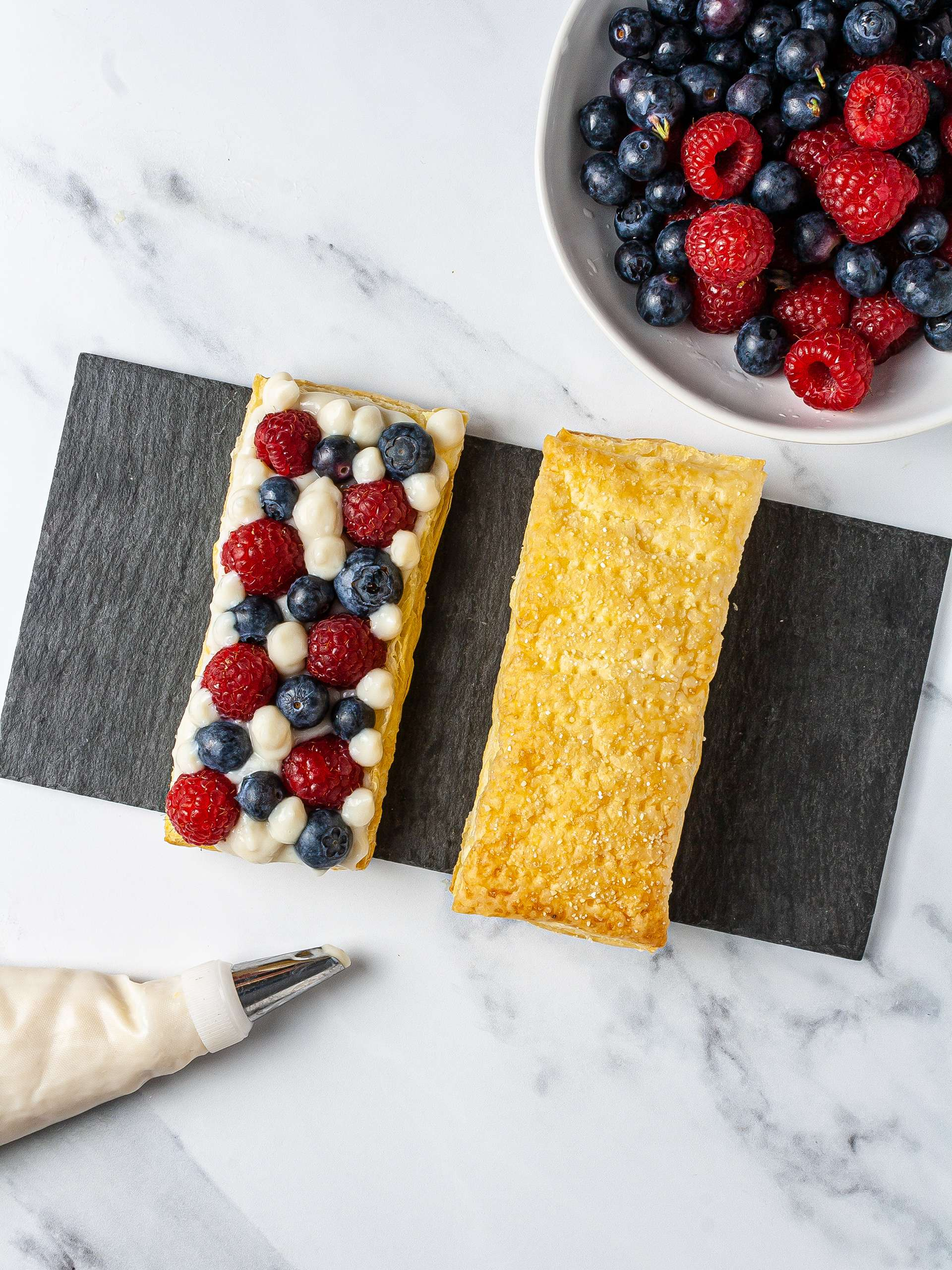 Puff pastry with almond cream, blueberries, and raspberries