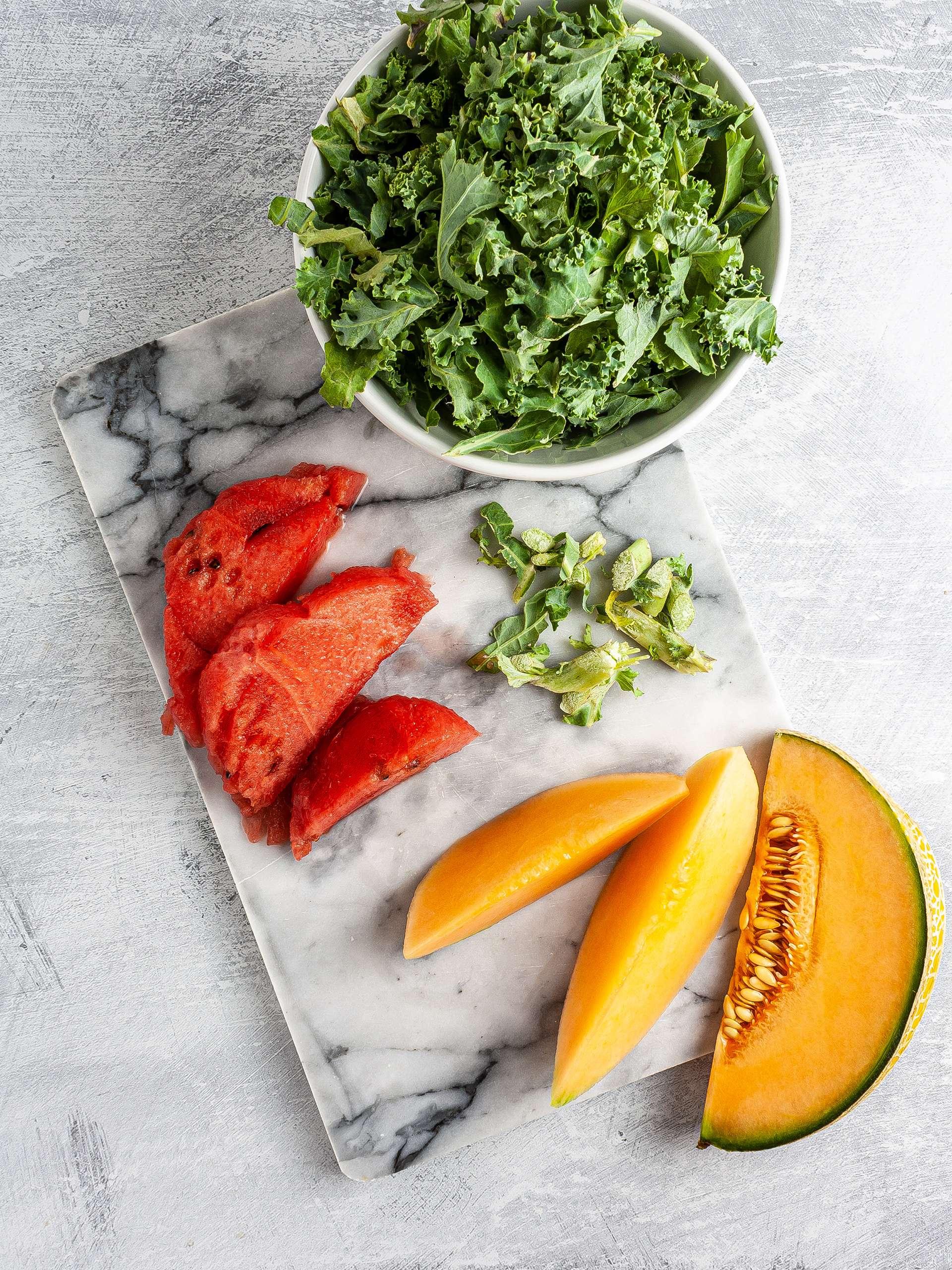 Shredded kale, sliced melon and watermelon