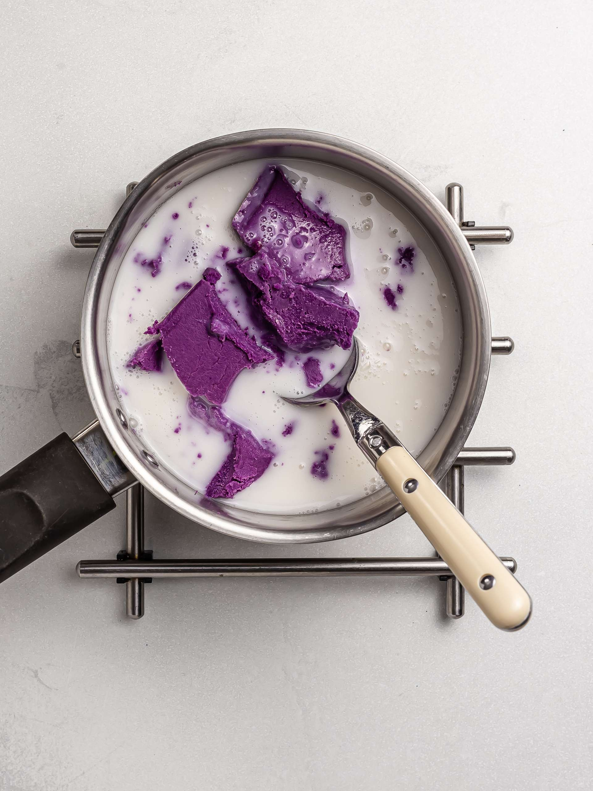 melting ube butter with milk in a pot