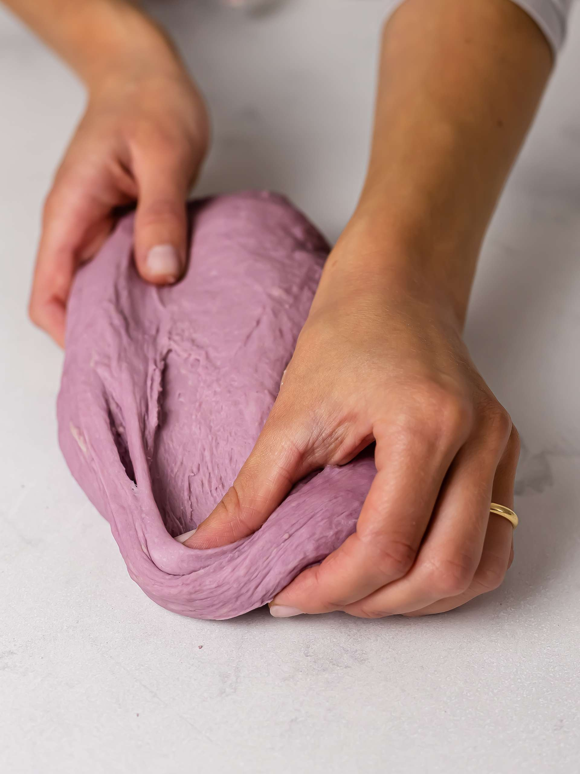 kneading purple ube donut dough