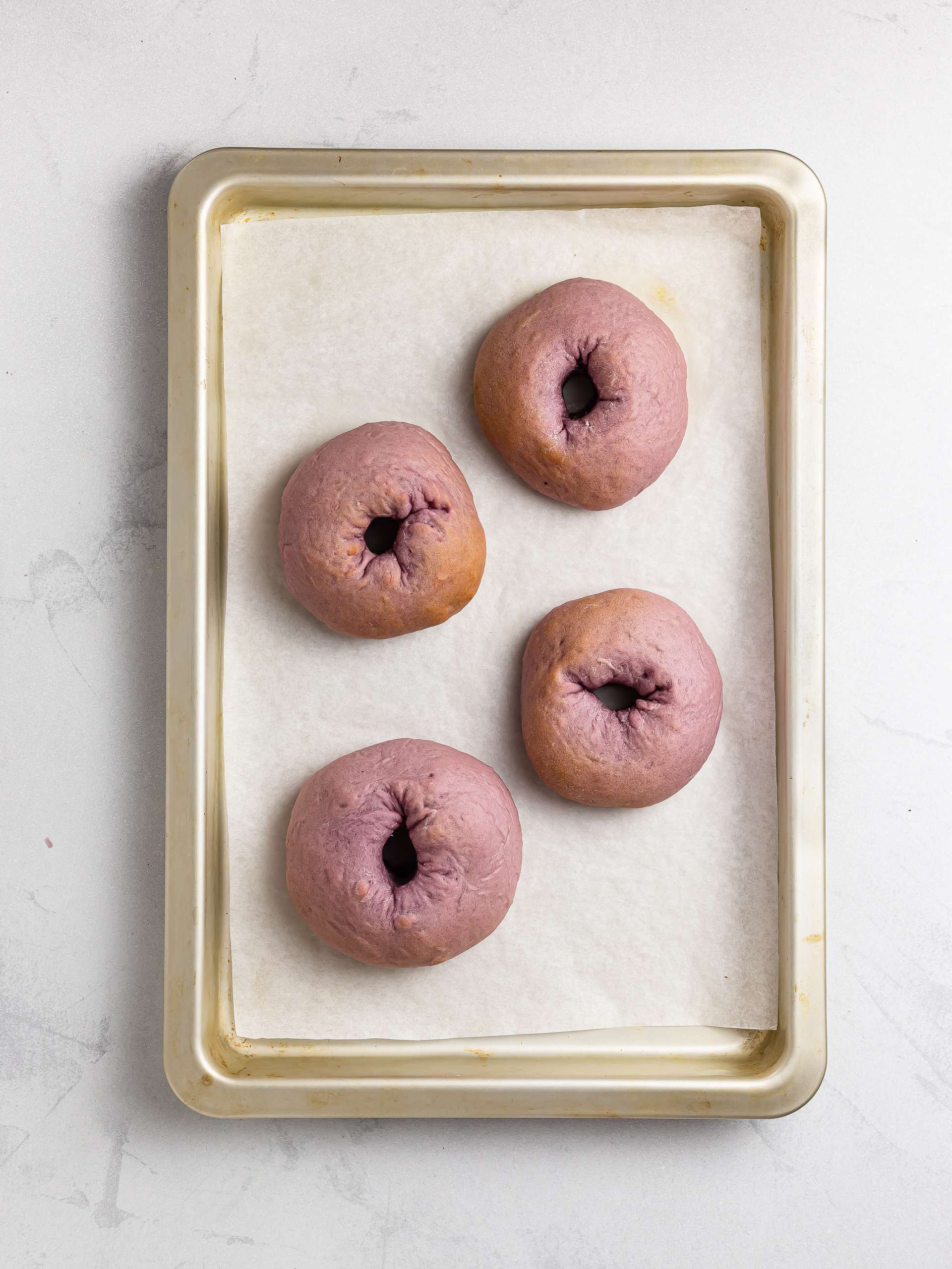 oven baked ube donuts on a tray