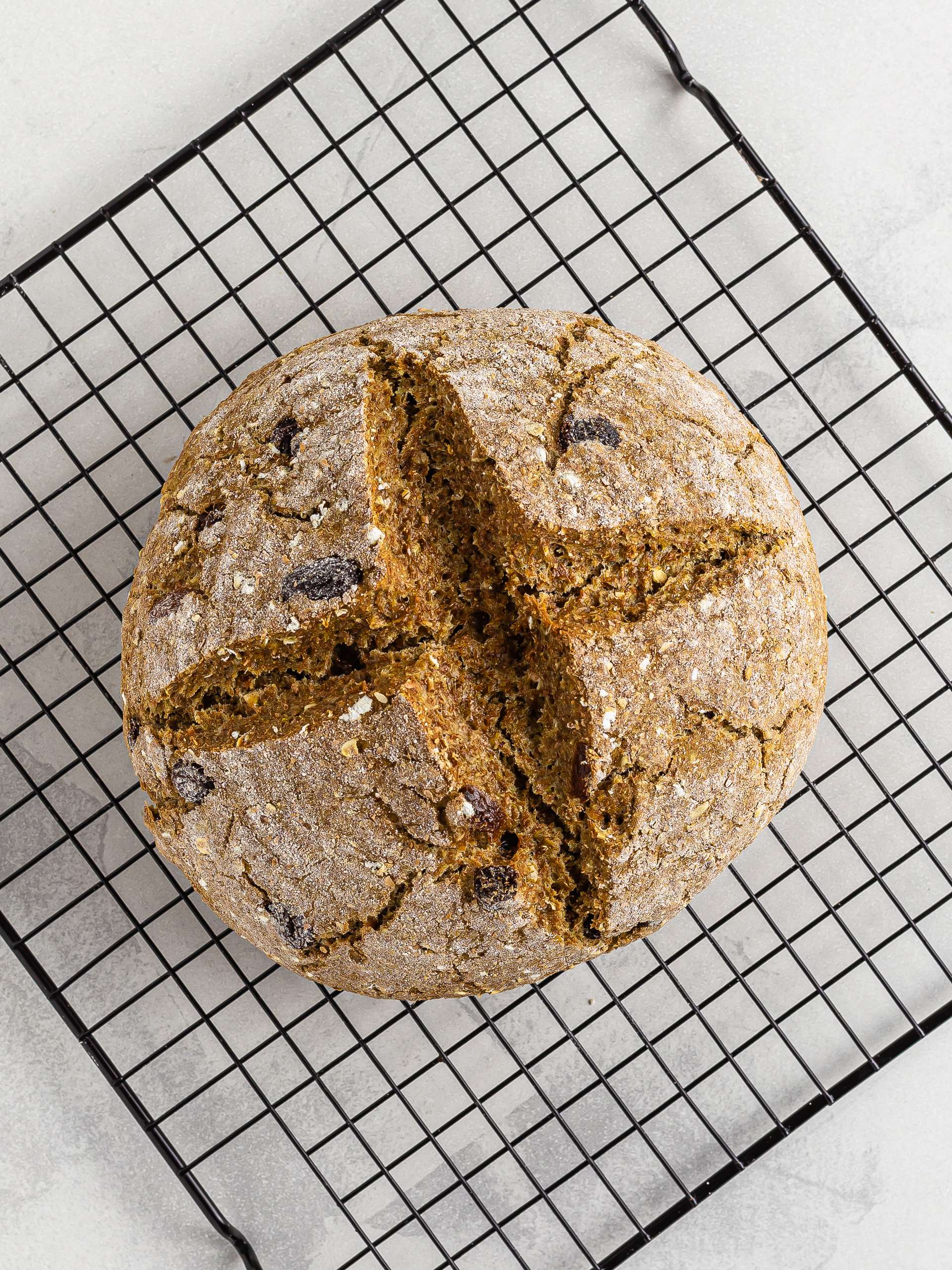 baked irish soda bread on a cooling rack