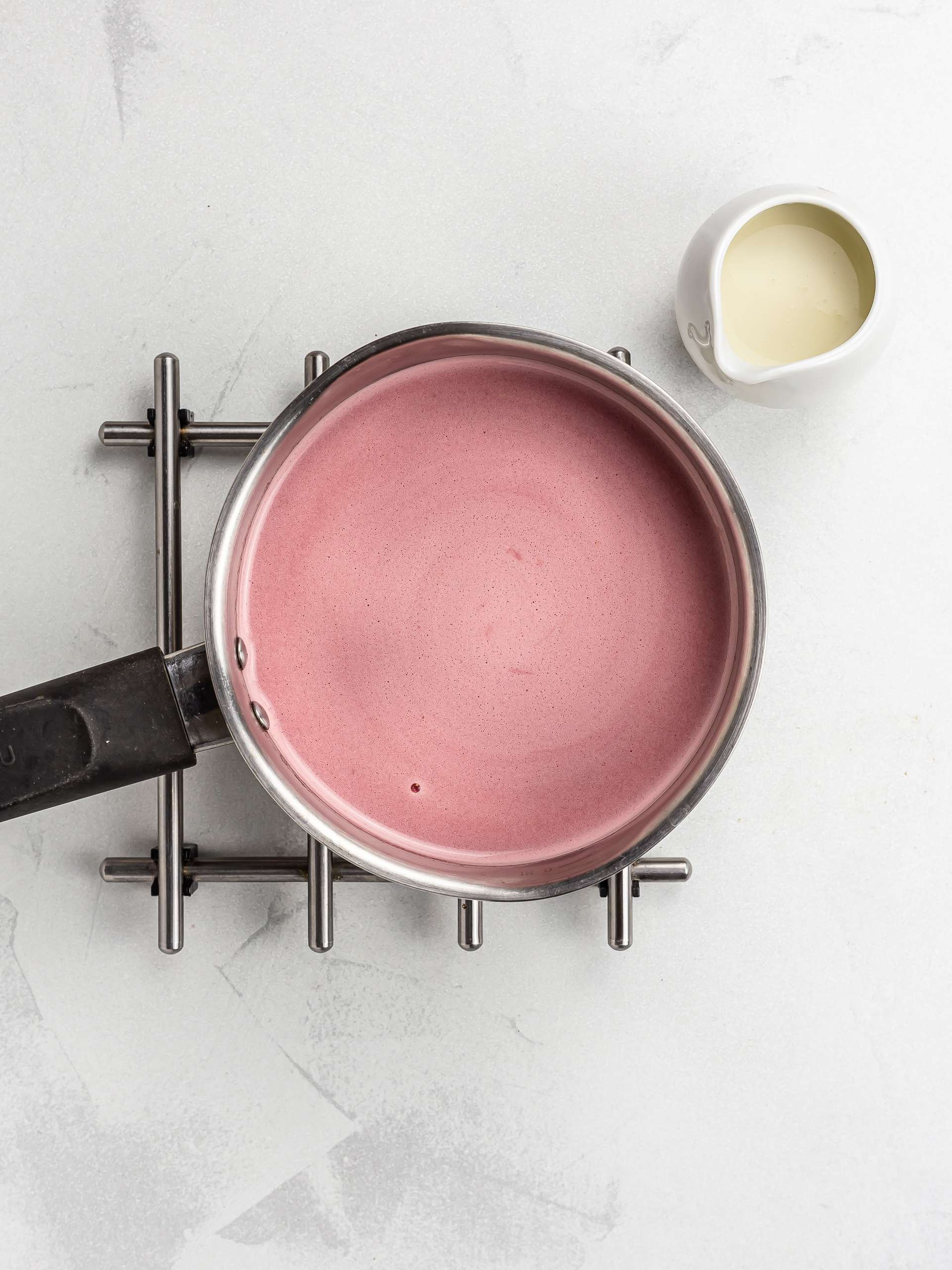 warm beet milk with cardamom and maple syrup