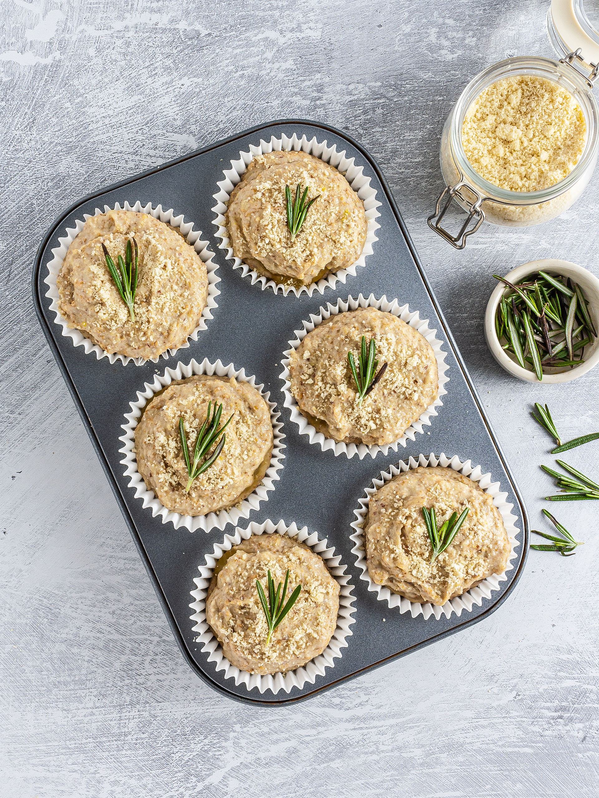 Muffins garnished with rosemary