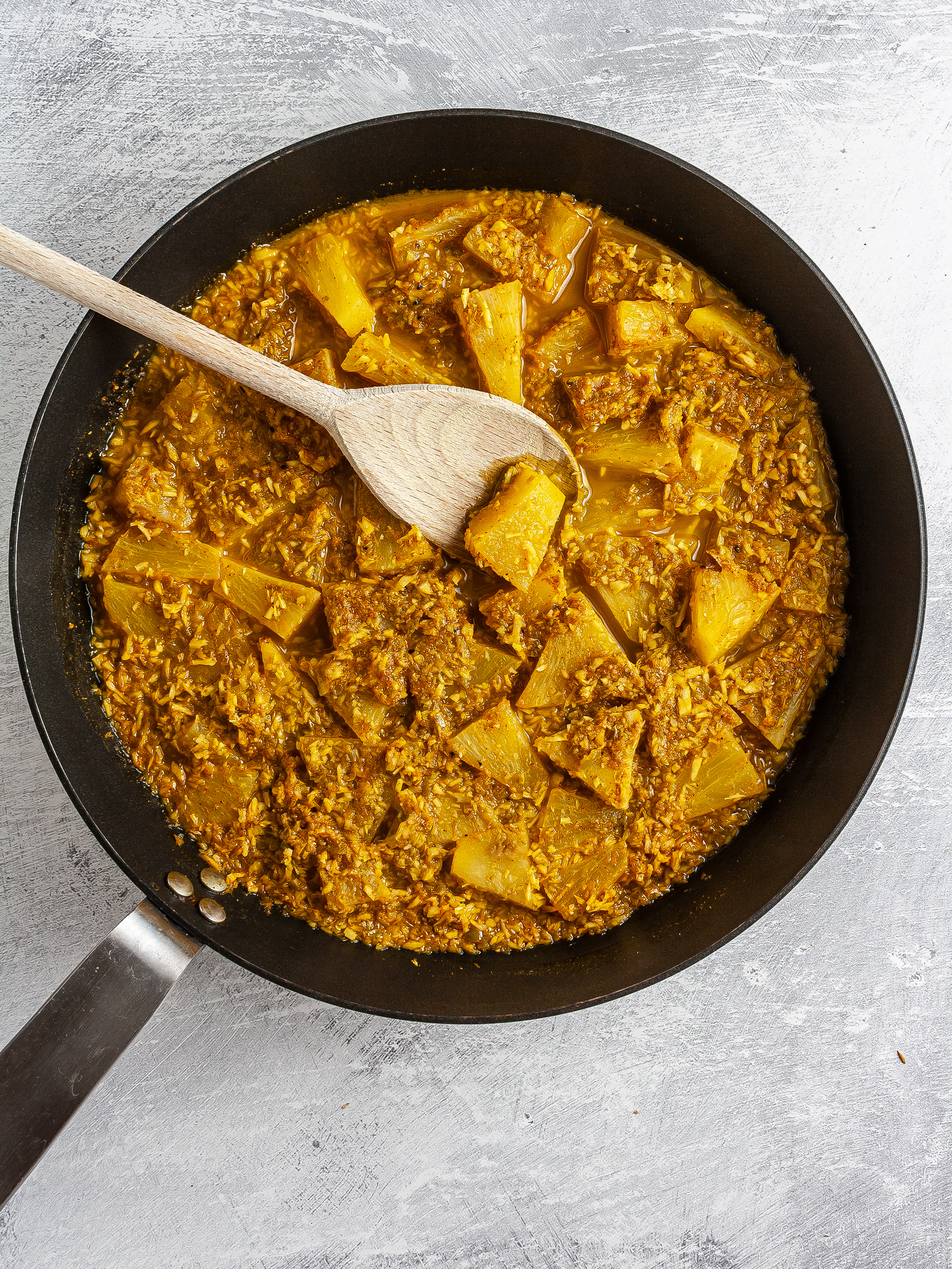 Pineapple curry with coconut and green chillies