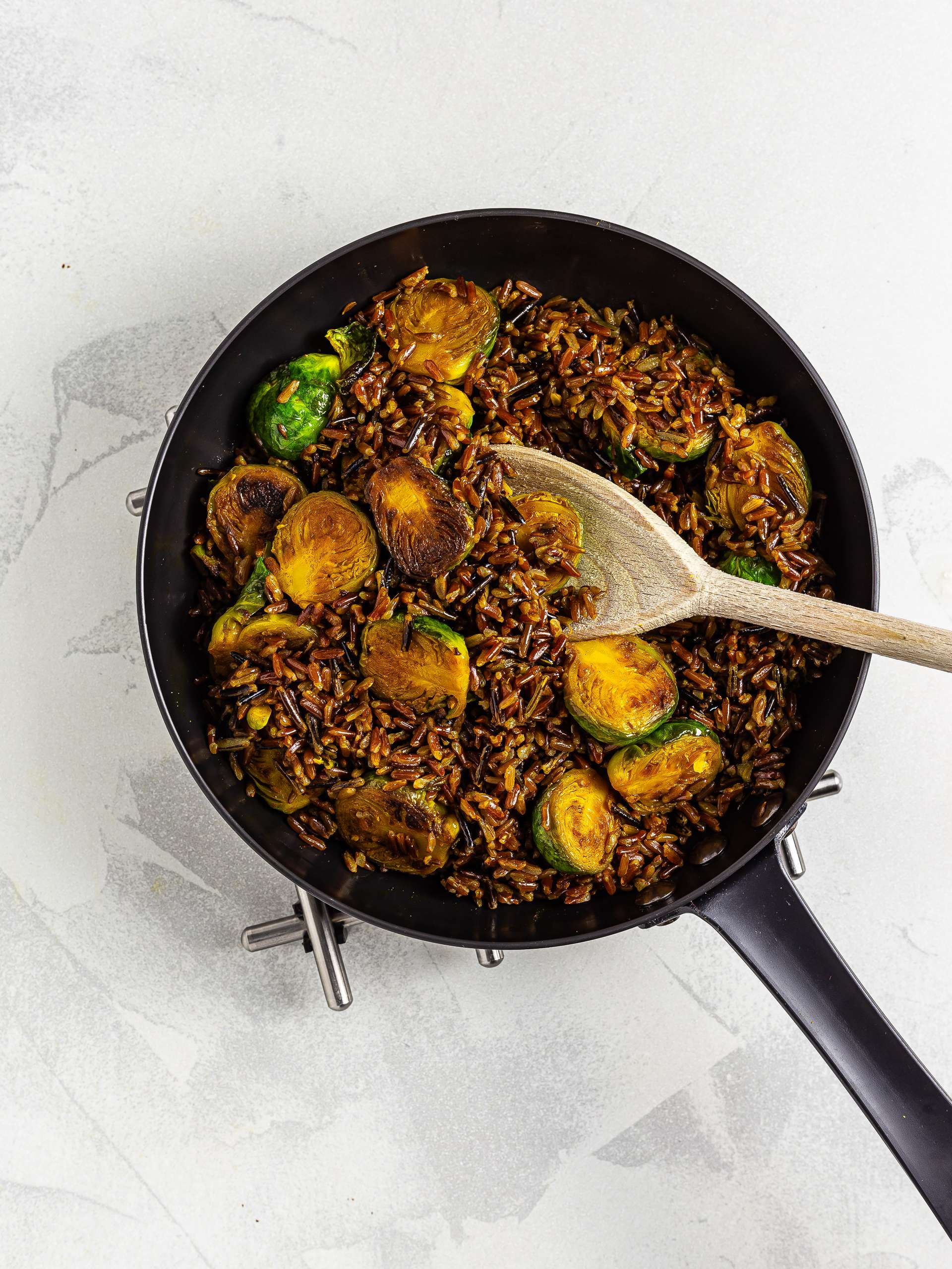 red rice with brussel sprouts in a skillet