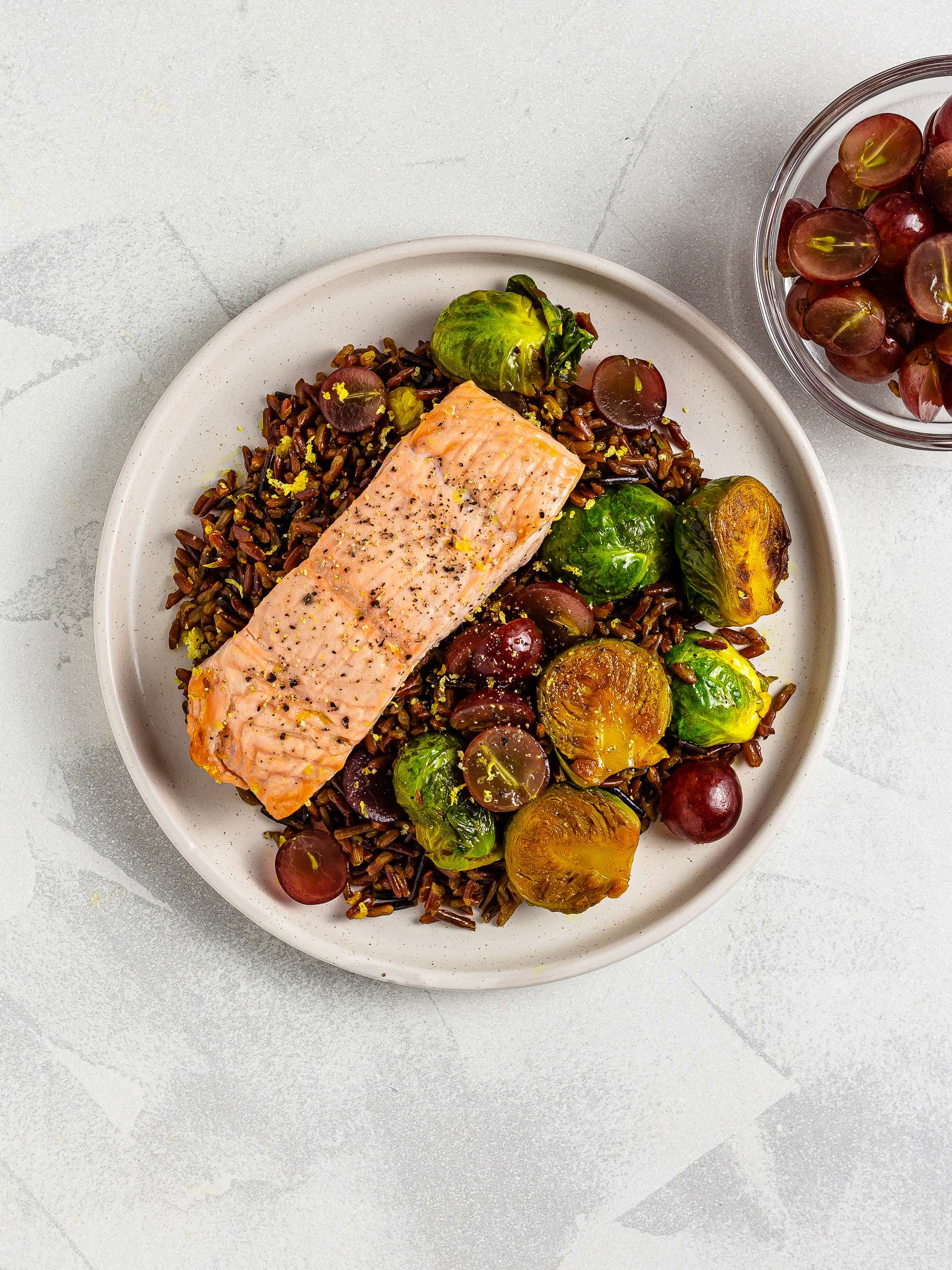 salmon with red rice and grapes salad