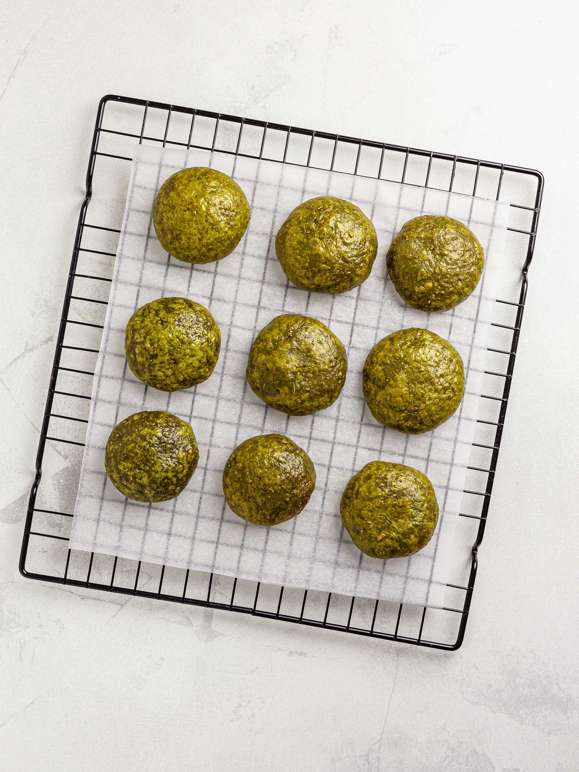 steamed matcha manju cooling down on a wire rack