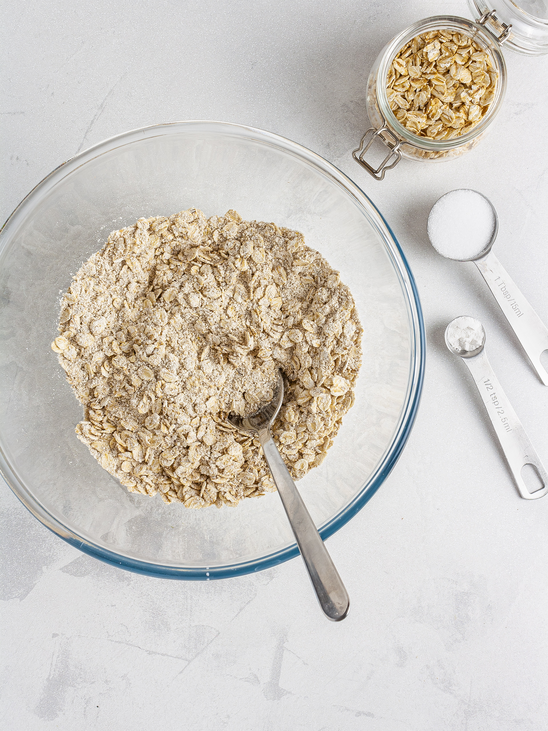 Oat flour, oat flakes, erythritol, and baking powder in a bowl