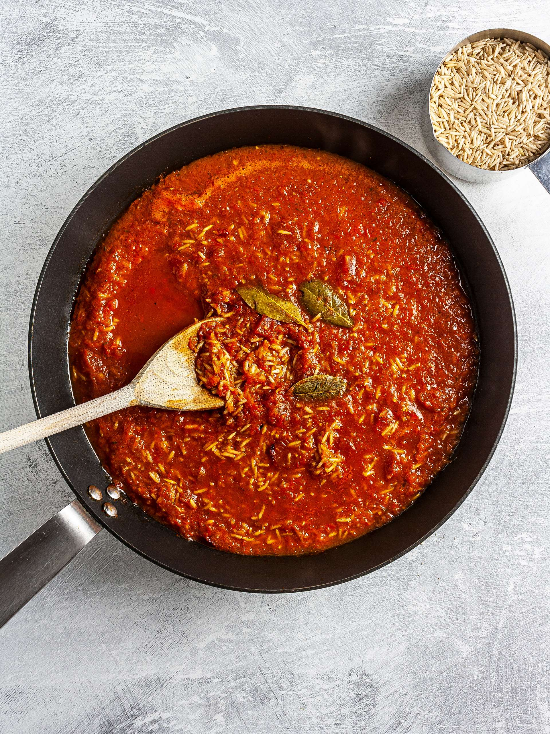 Rice cooking in tomato sauce