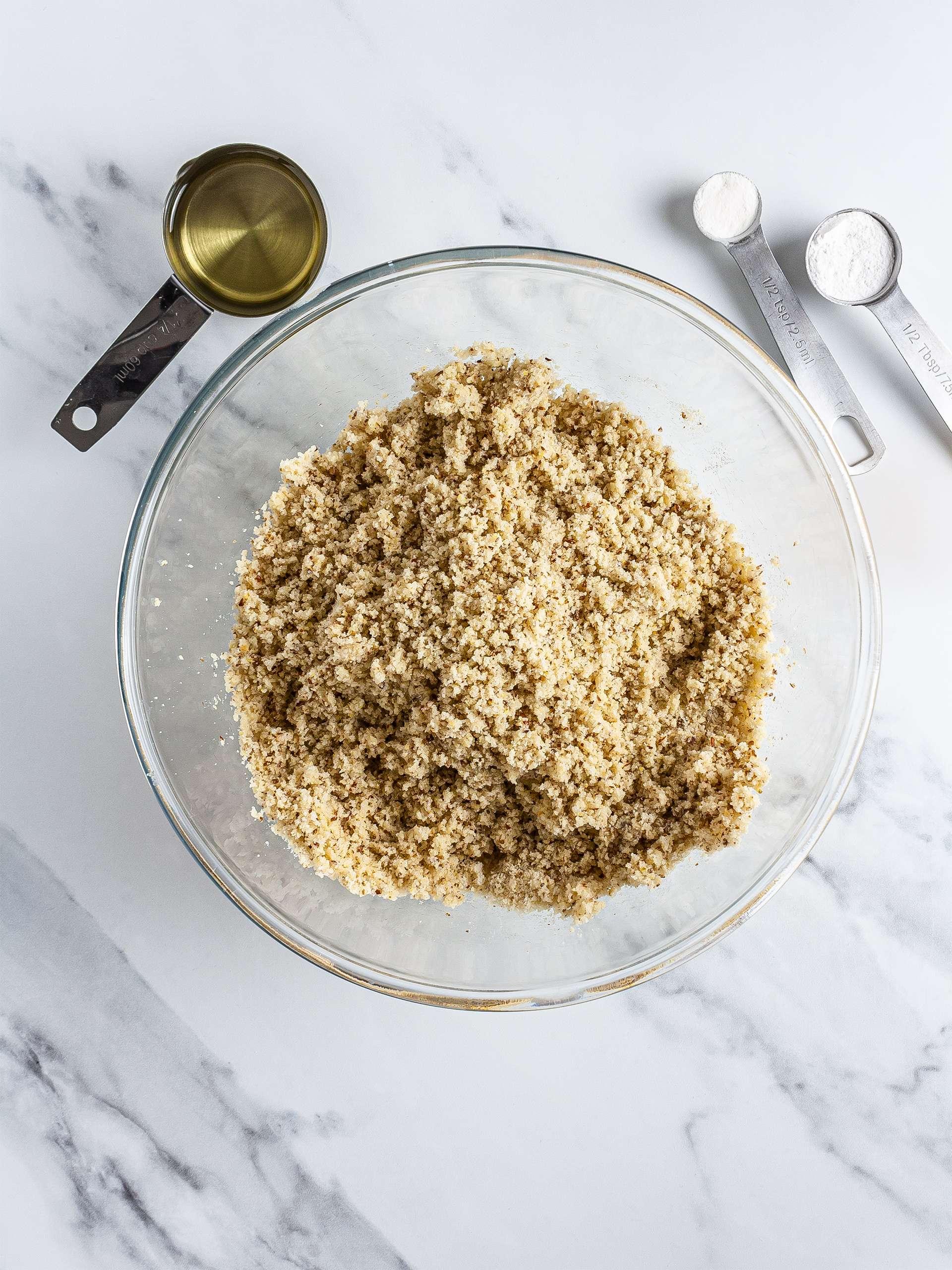 Almond flour mixed with oil, xanthan gum, baking powder