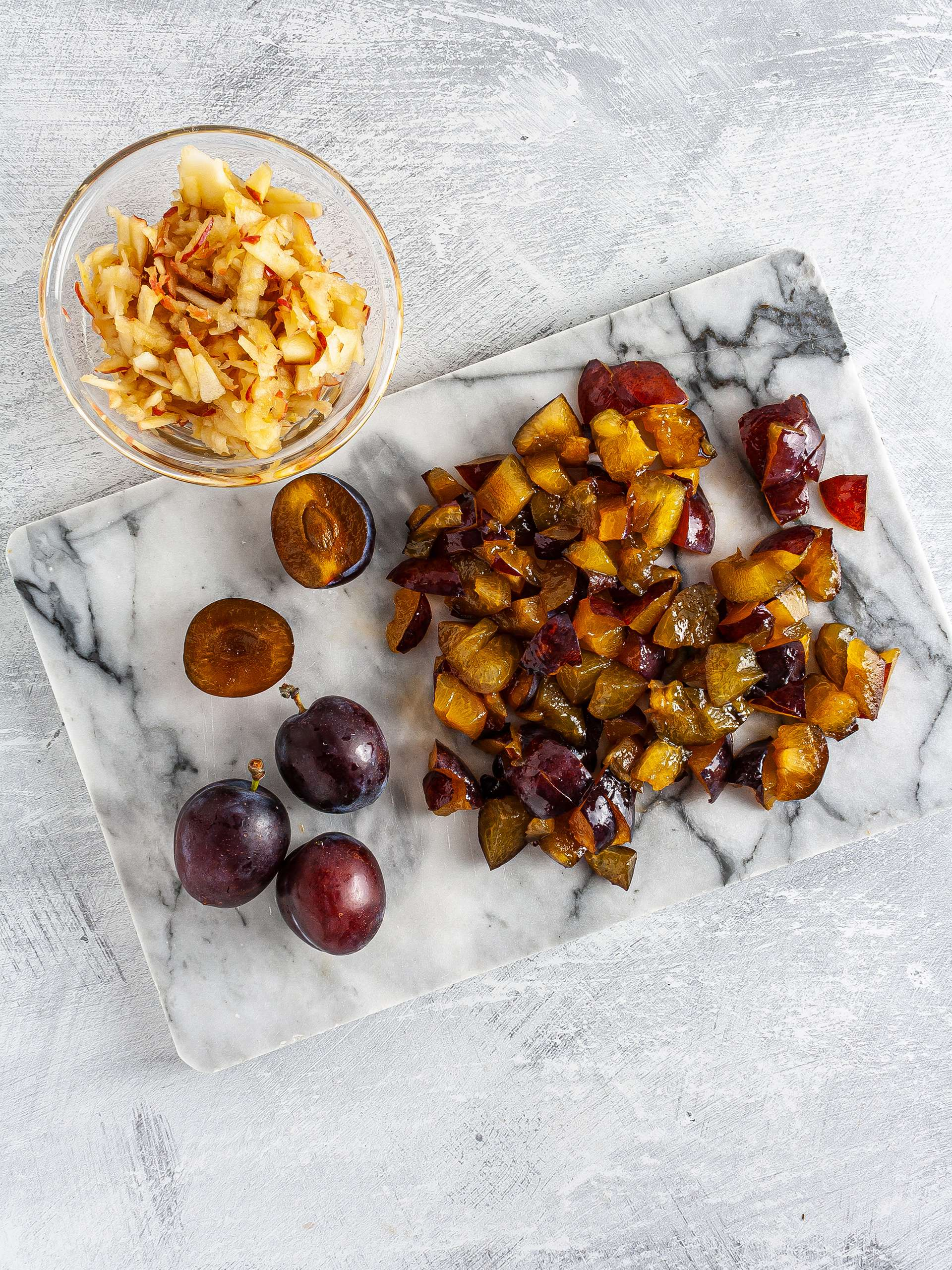 Chopped plums and grated apple