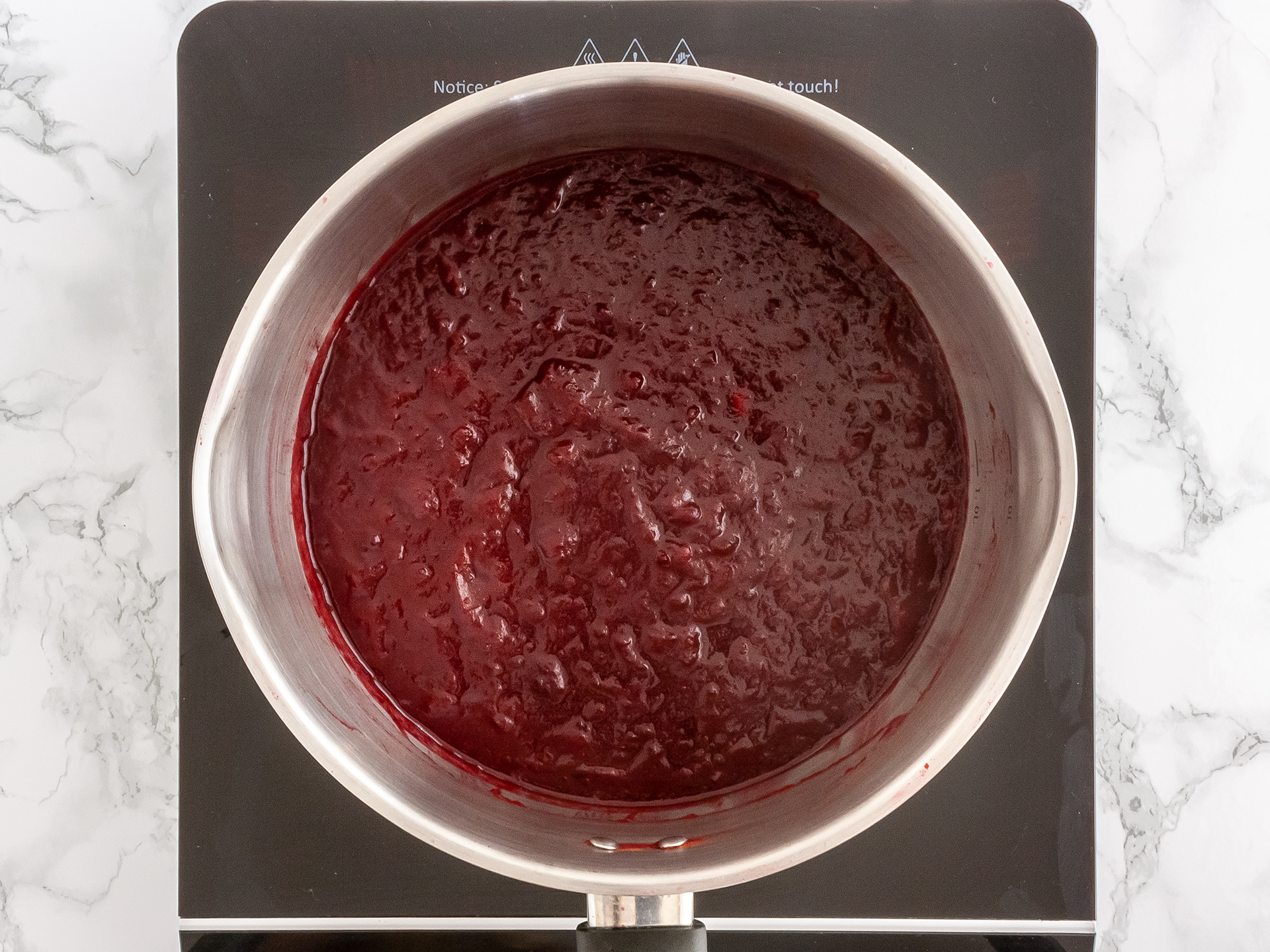 Thick and glossy sugar free plum jelly in a pot