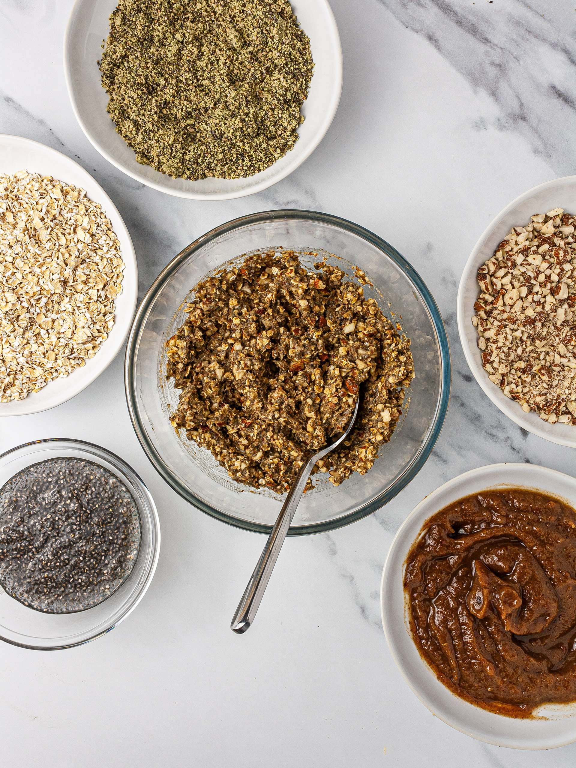 Protein energy balls ingredients including oats, almonds, chia seeds, pumpkin seeds, hemp seeds, and dates