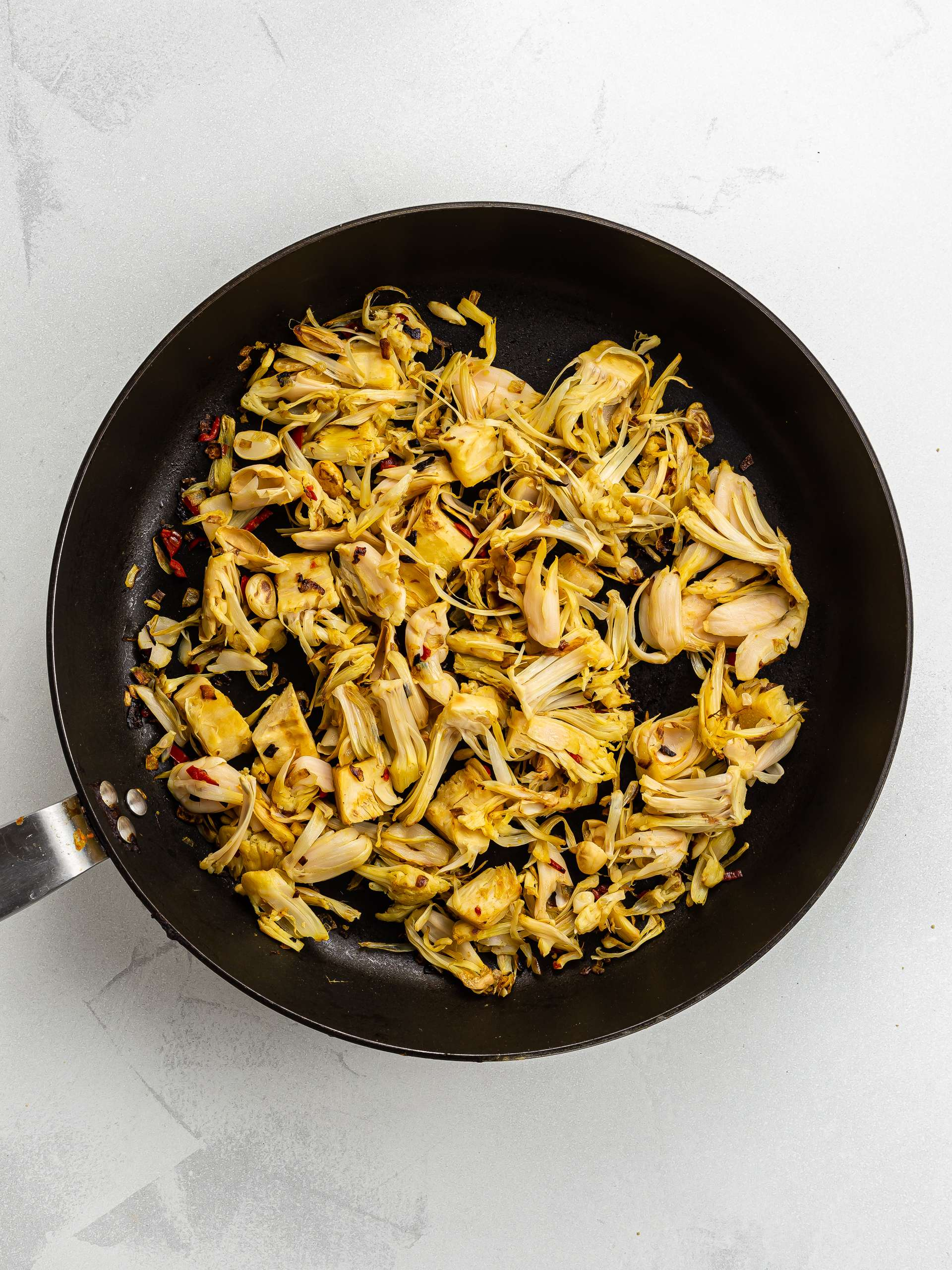 cooked pulled jackfruit in a skillet