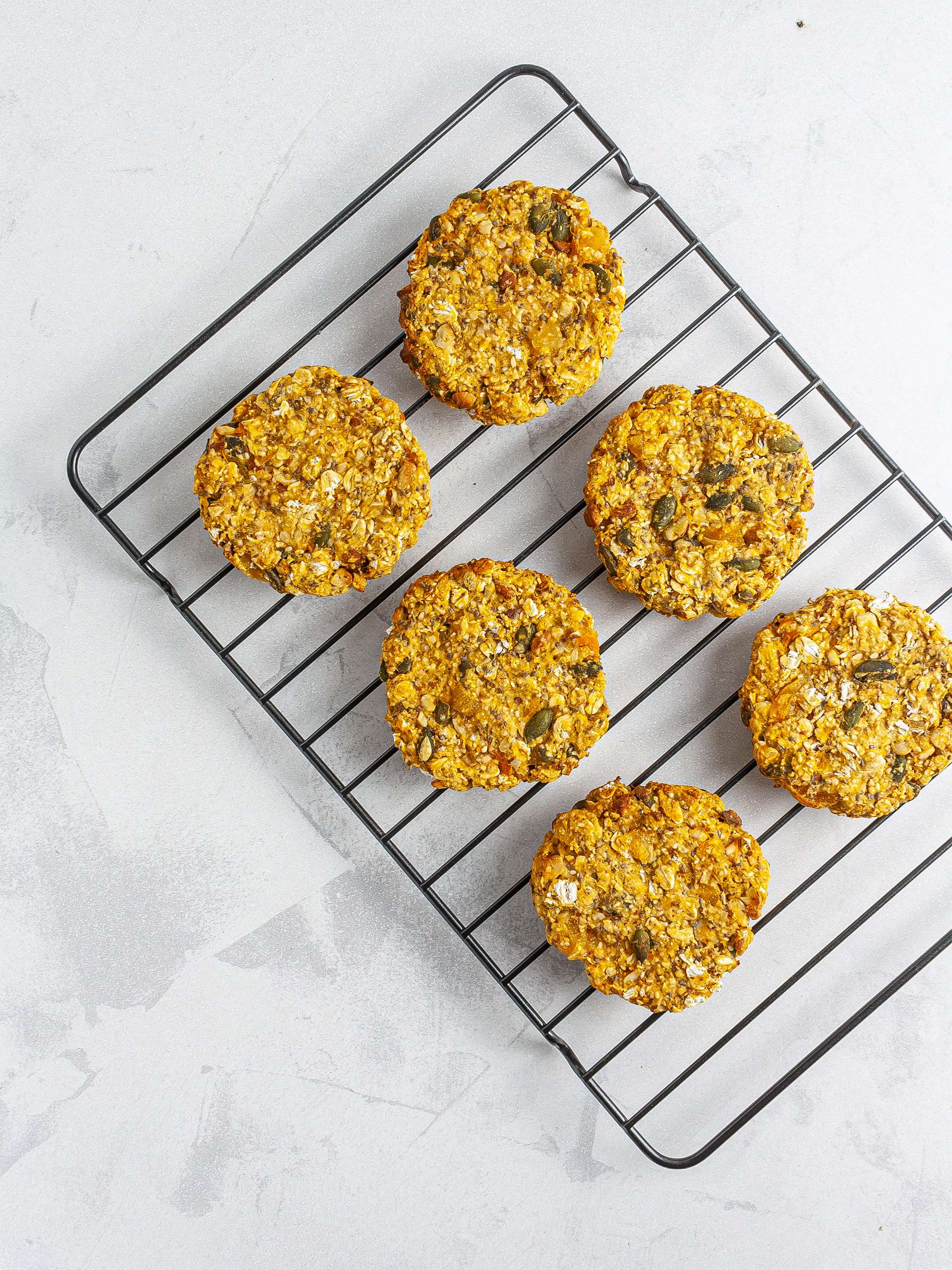 Baked sweet potato cookies on a cooling rack