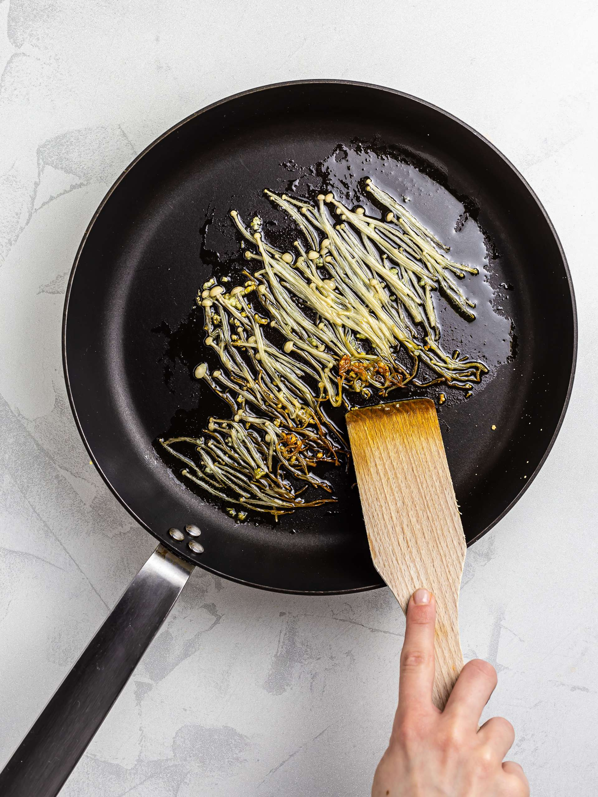 enkoi mushrooms sautéed with garlic and sesame oil