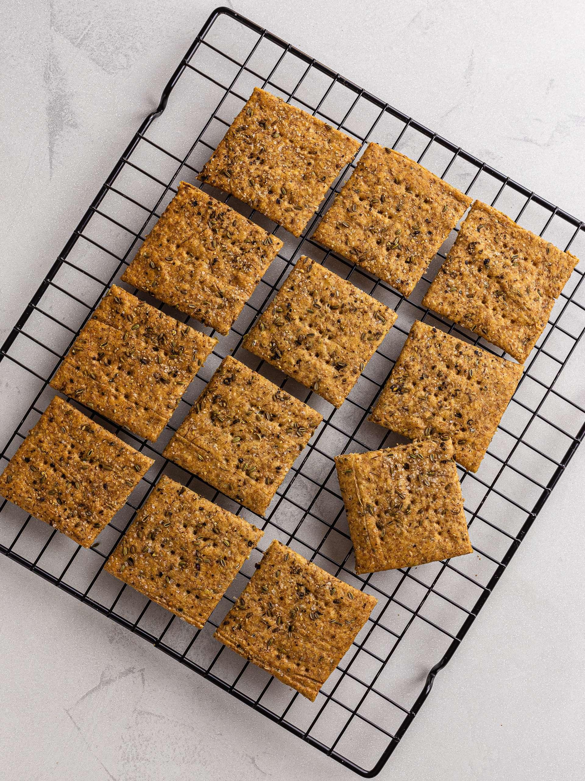 baked fennel sourdough crackers on a rack