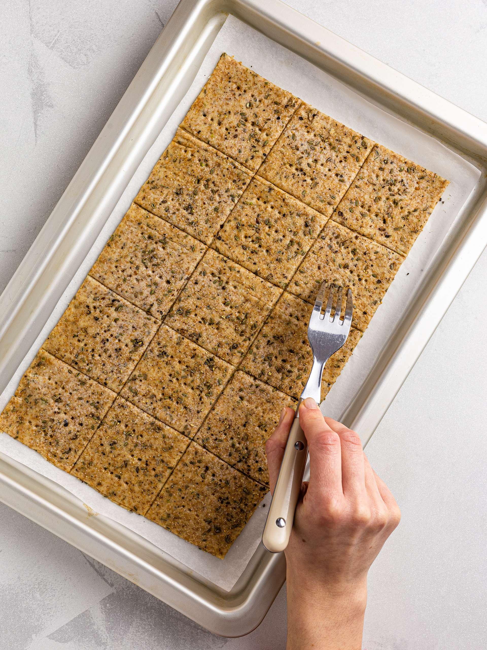 cut crackers shapes pricked with a fork