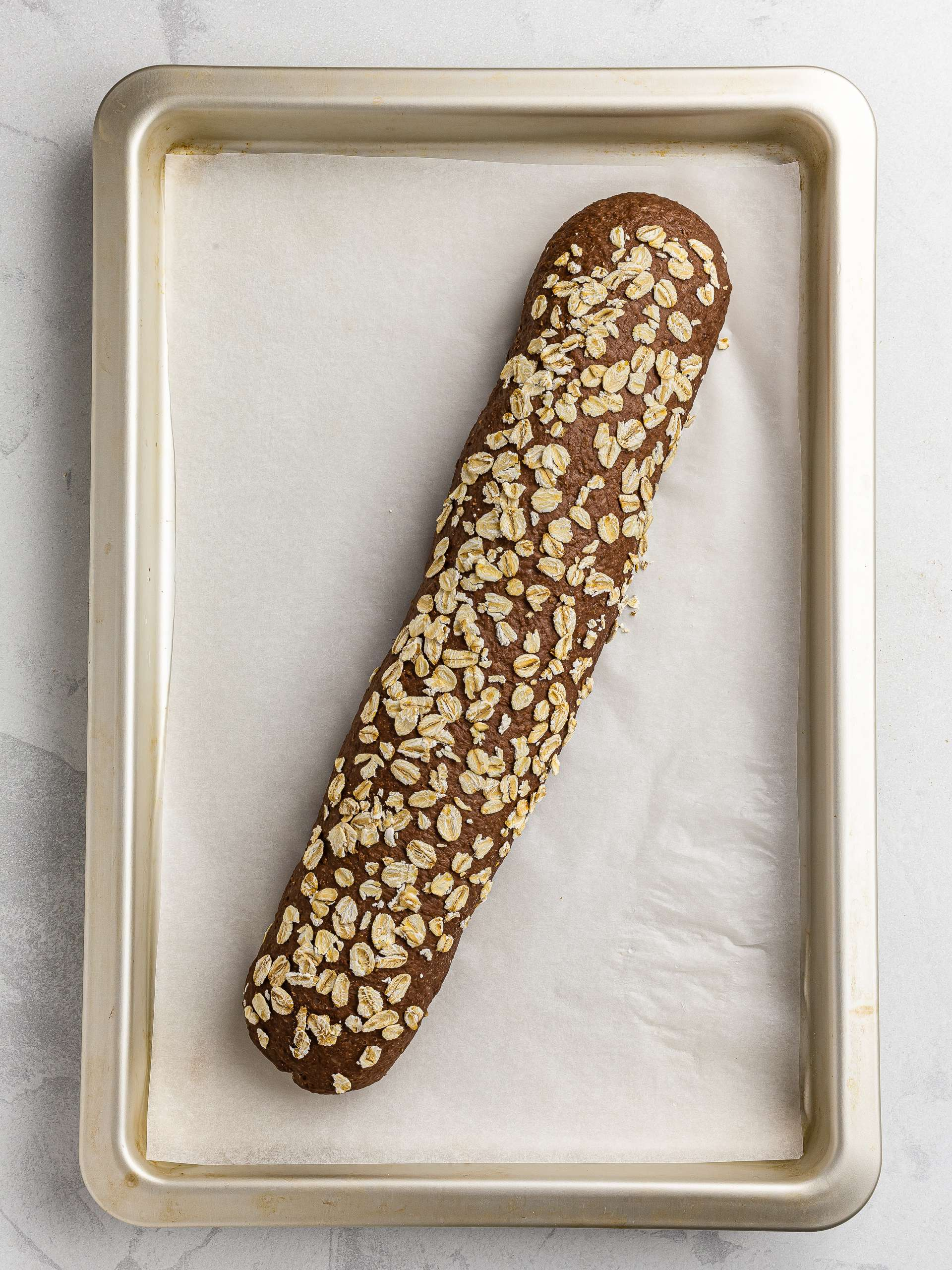 proved brown baguette with oats