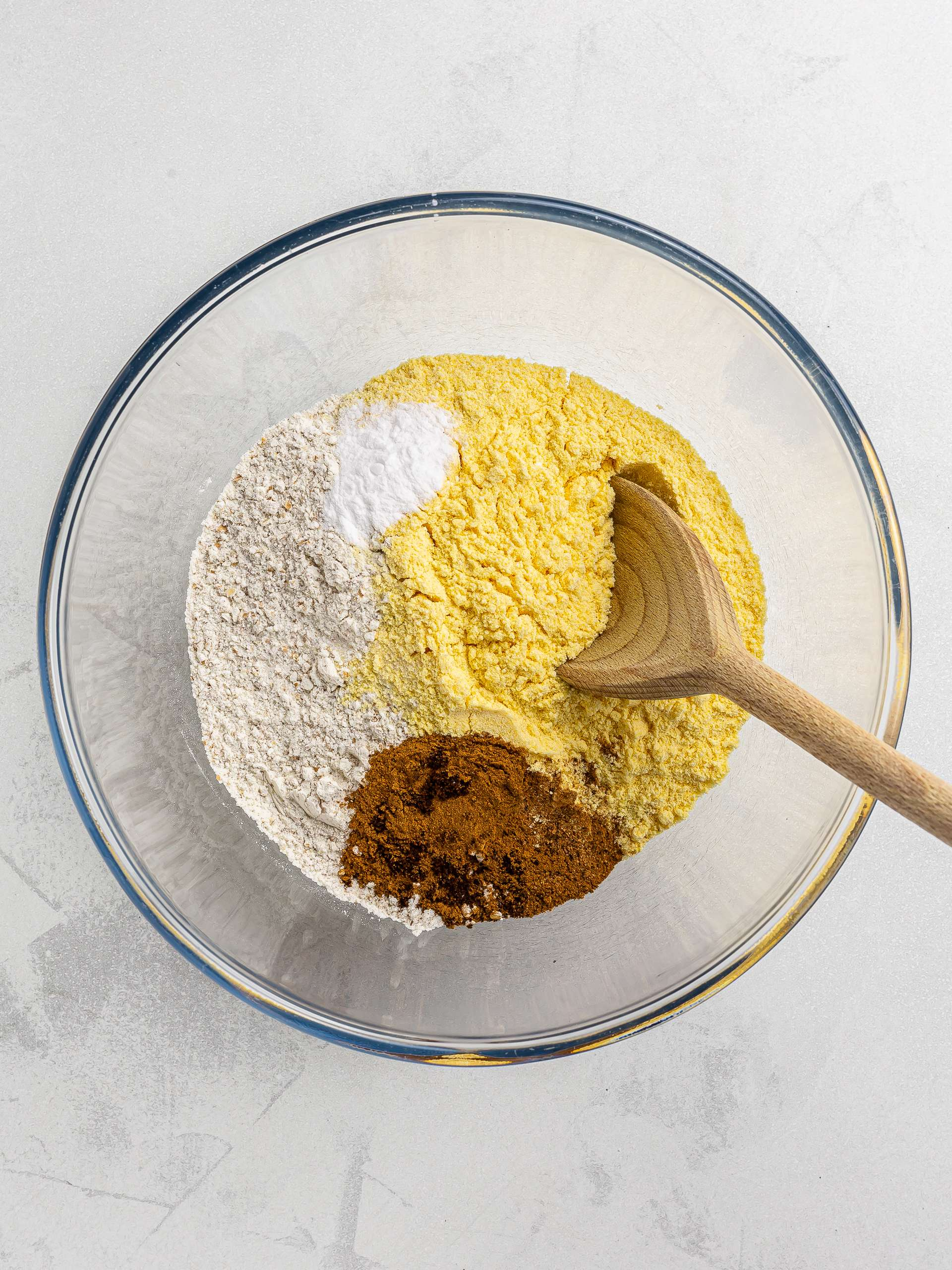 flour spices and cornmeal in a bowl