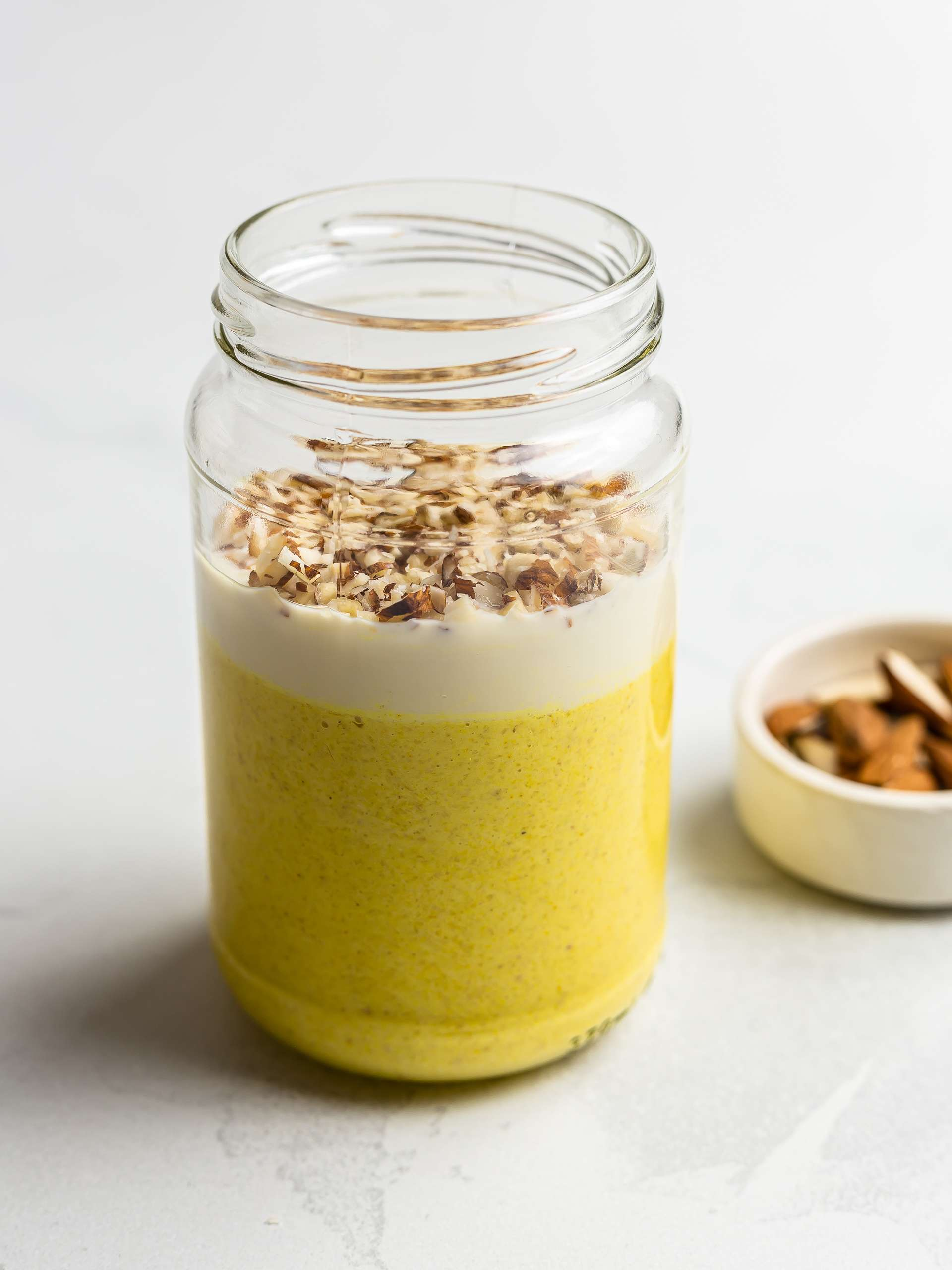 mango lassi oats in a jar with chopped almonds