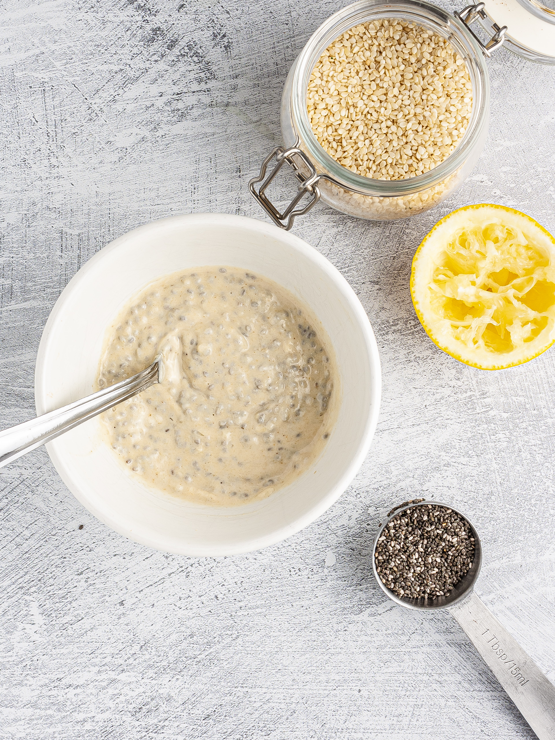 Dressing with tahini, lemon, and chia seeds.
