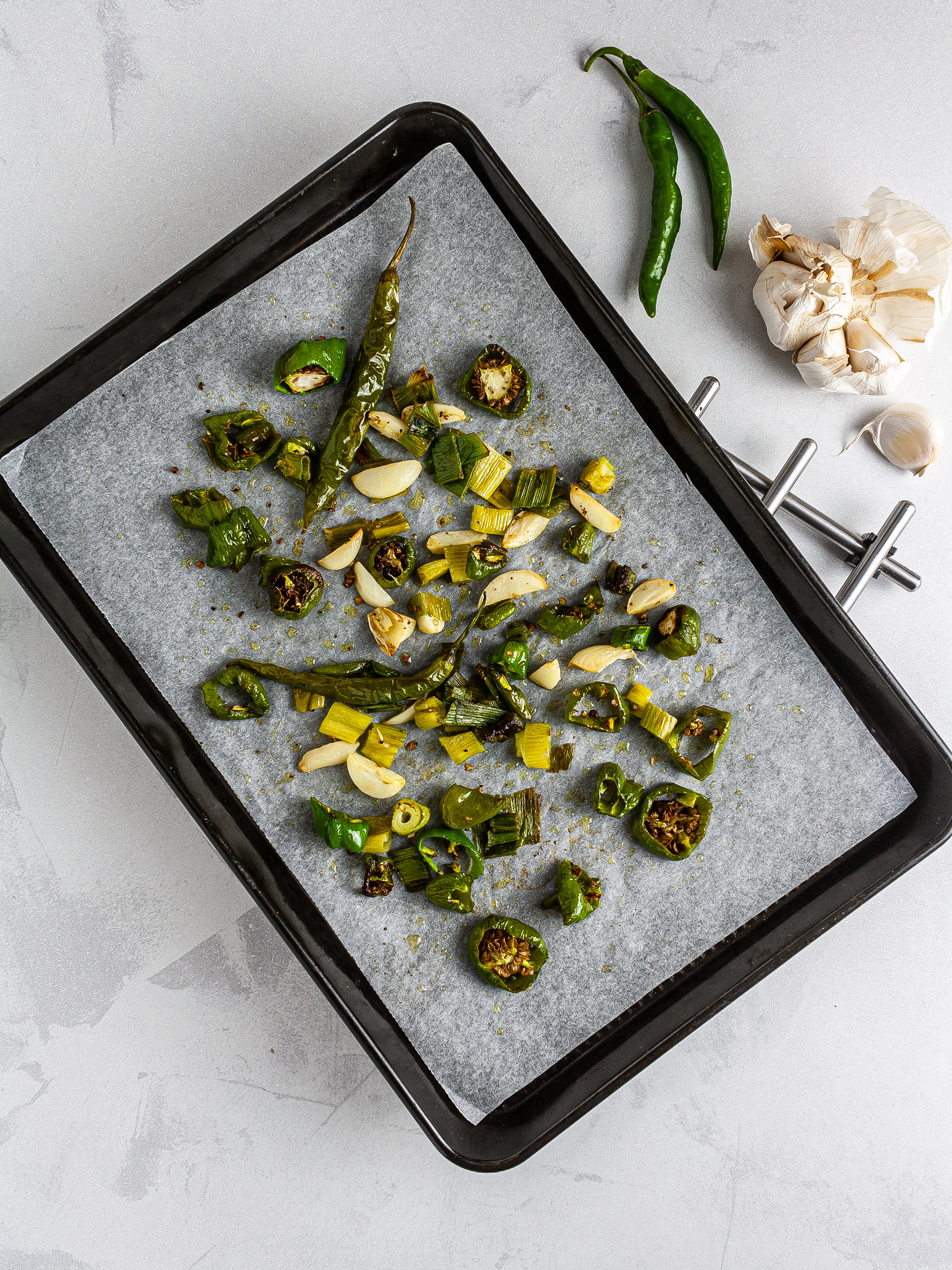 Roasted green chilli peppers with garlic and spring onions