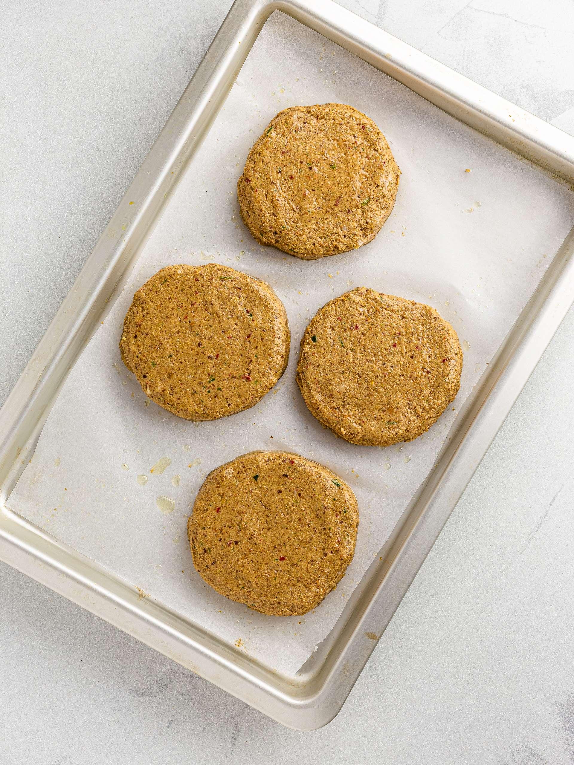 jackfruit burger patties on a baking tray