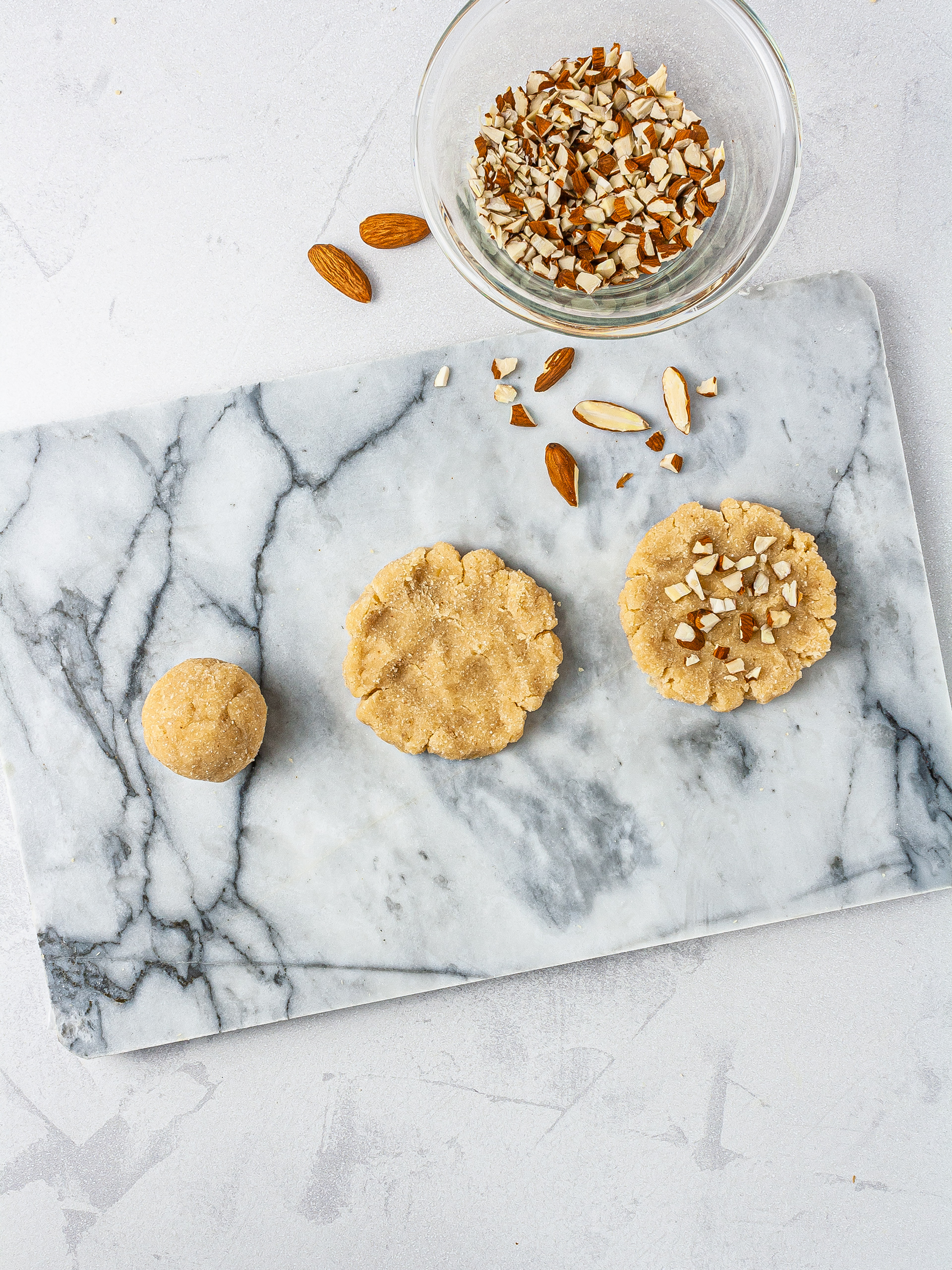 Almond cream cheese cookies on chopping board.