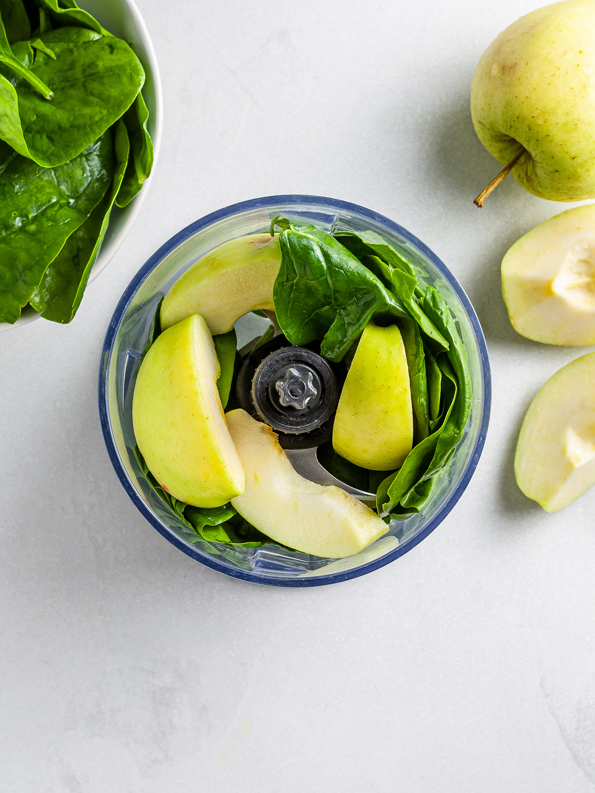 Apples and spinach in food processor