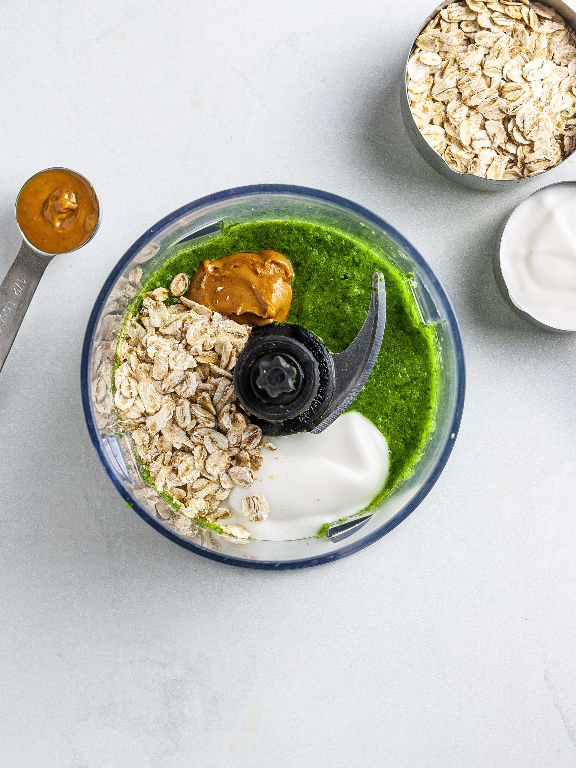 Oats, yogurt, almond butter added to green smoothie