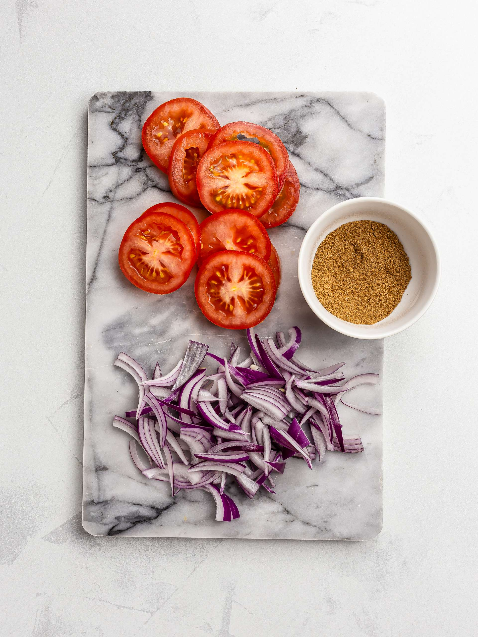 sliced onions and tomatoes for moussaka