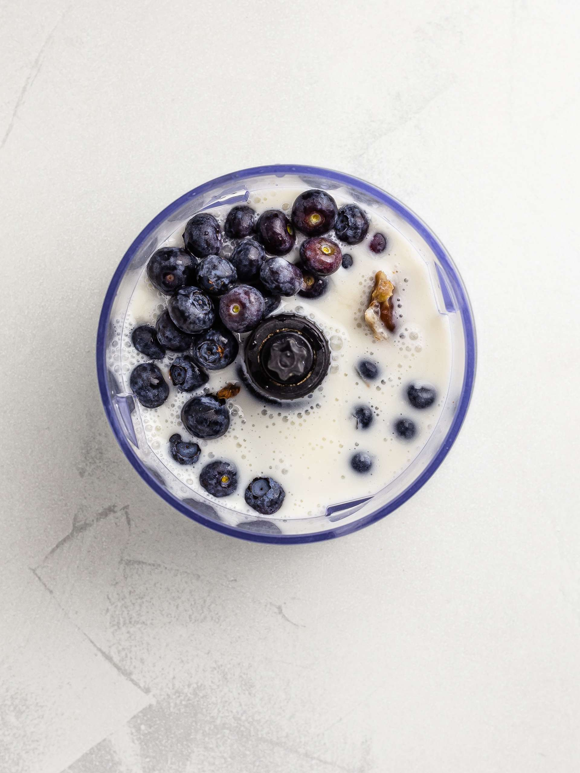blueberries, almond milk and yogurt in a blender