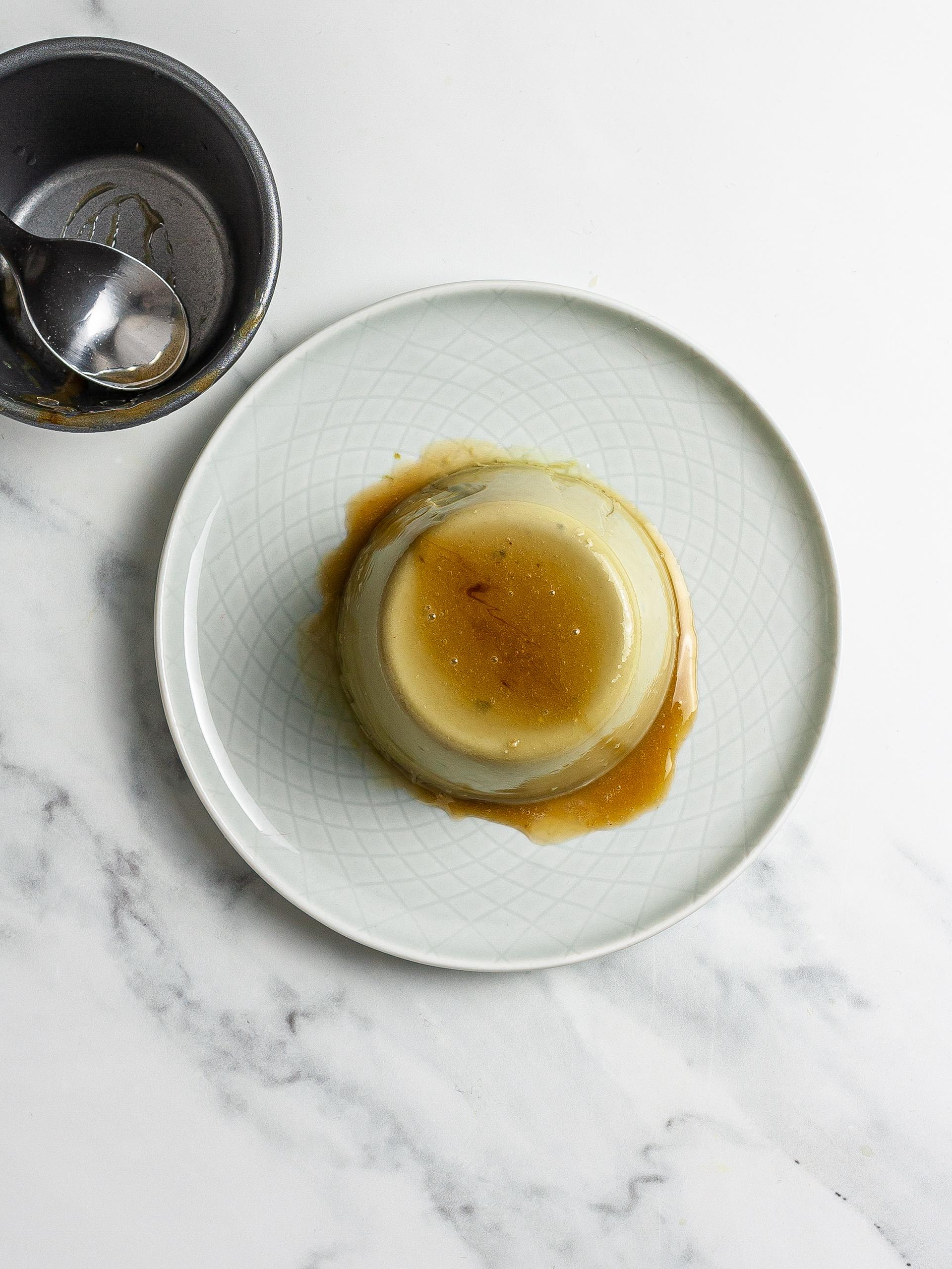 Matcha flan flipped on a plate