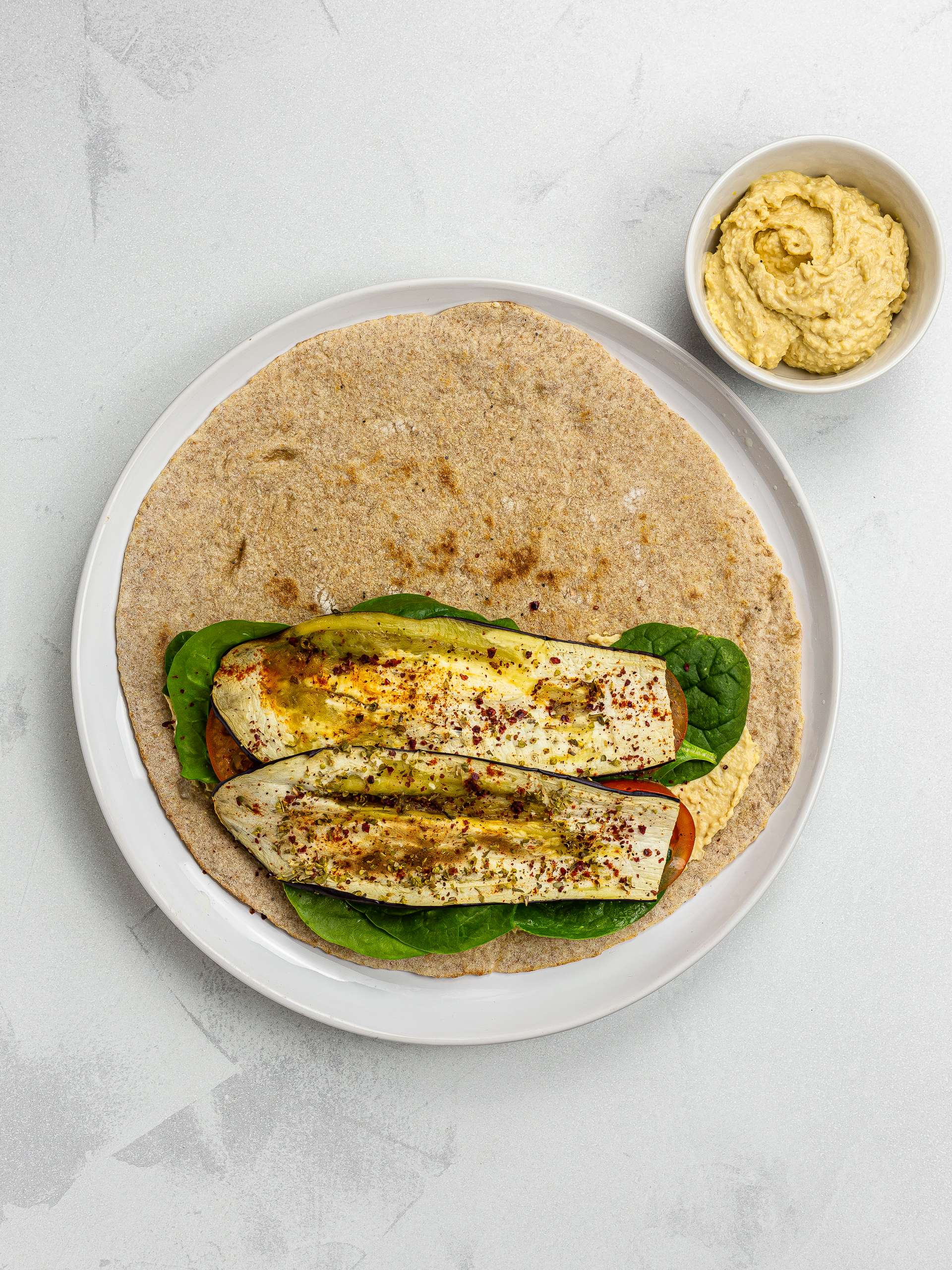 lavash bread wrap with hummus and grilled aubergines