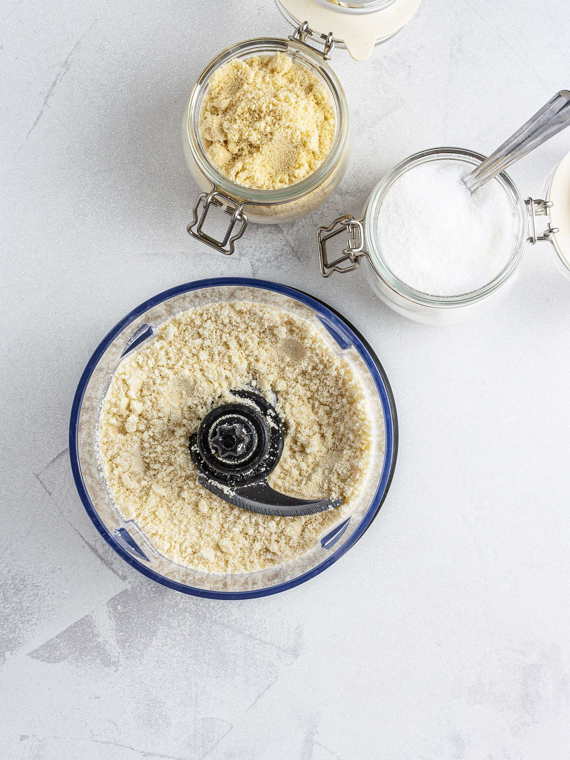 Almond flour and erythritol in a food processor