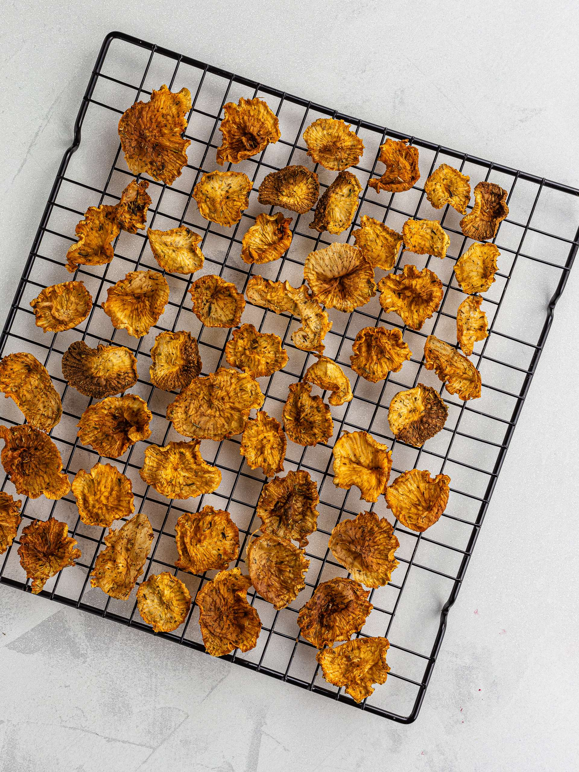 oven-baked daikon chips on a rack