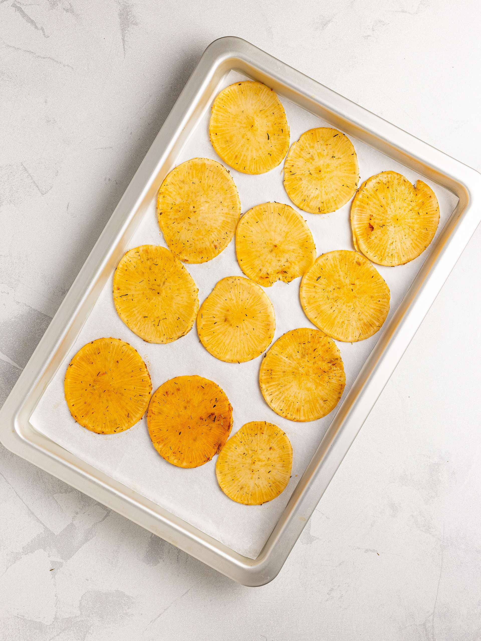 daikon chips on a baking tray