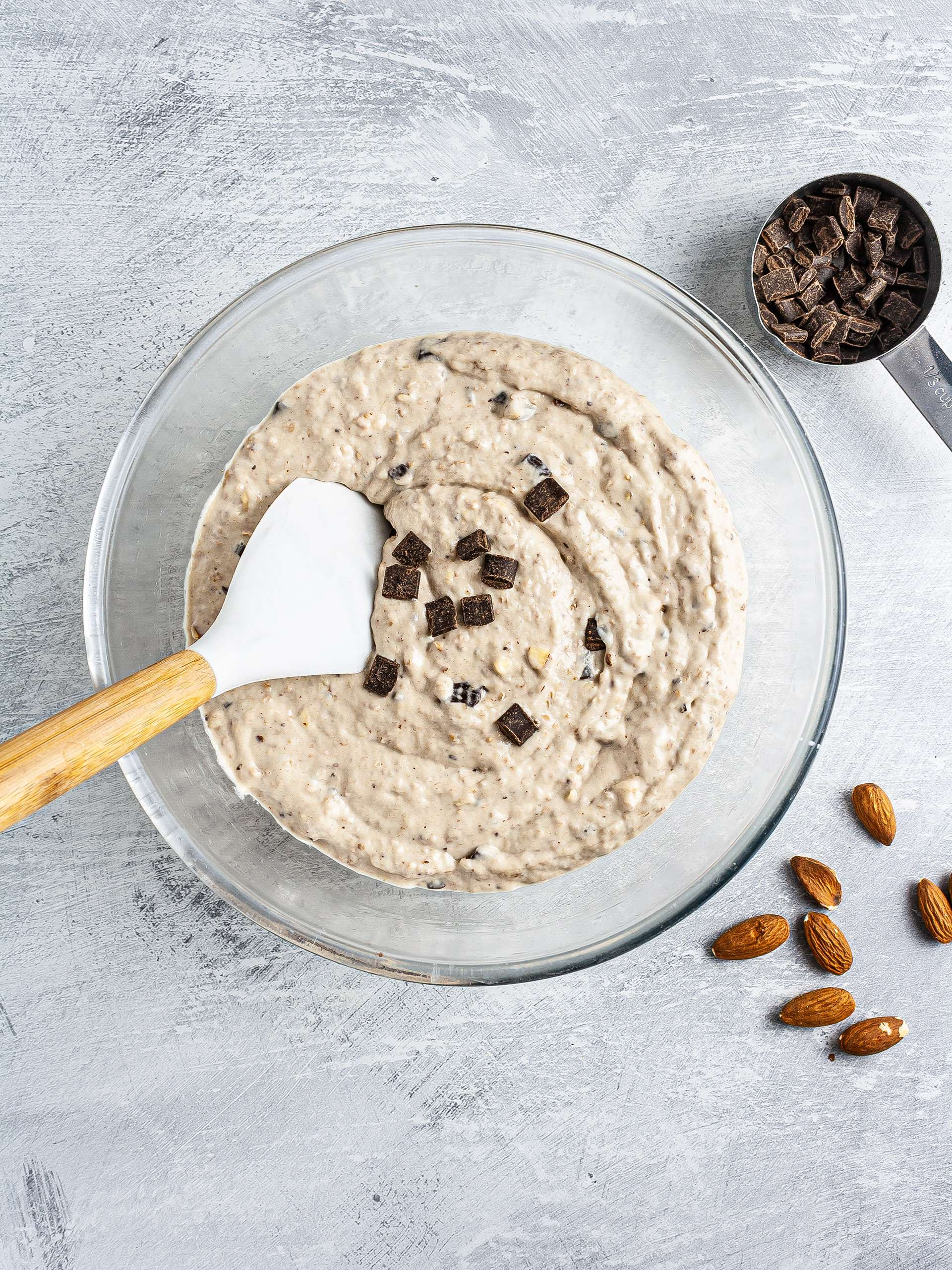 Chocolate chips and chopped almonds in the loaf batter