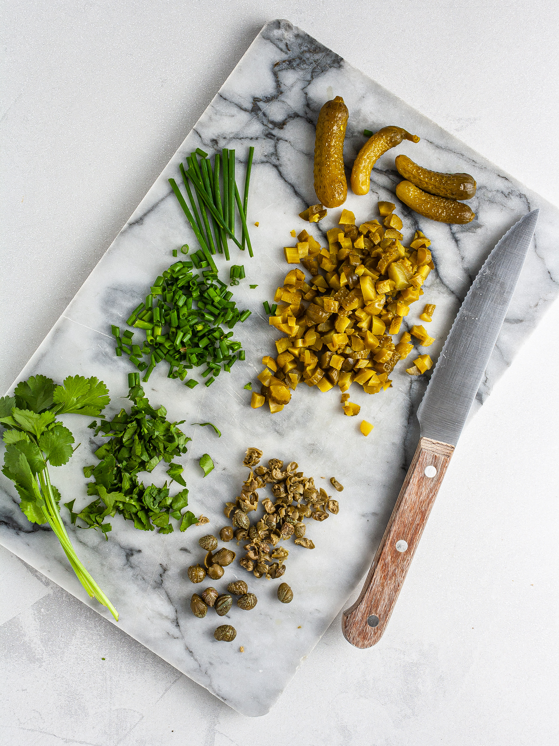 Chopped capers, gherkins and herbs