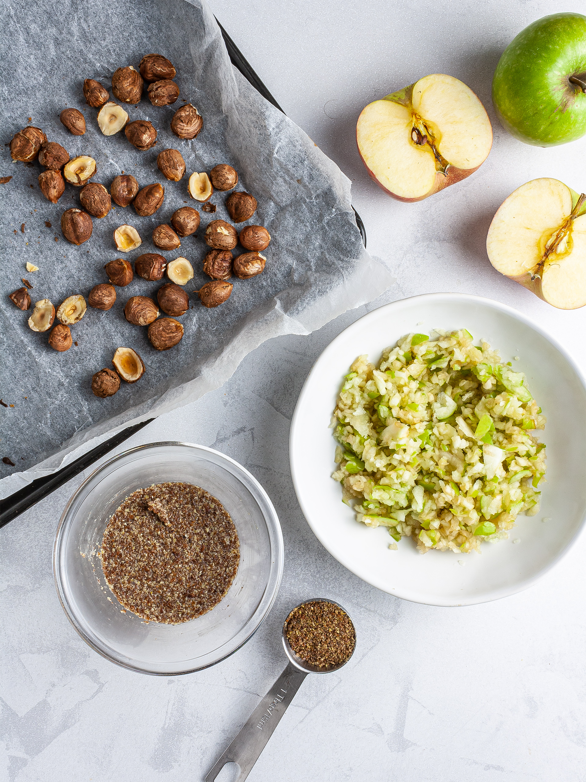 Grated apples, flaxseeds and roasted hazelnuts.