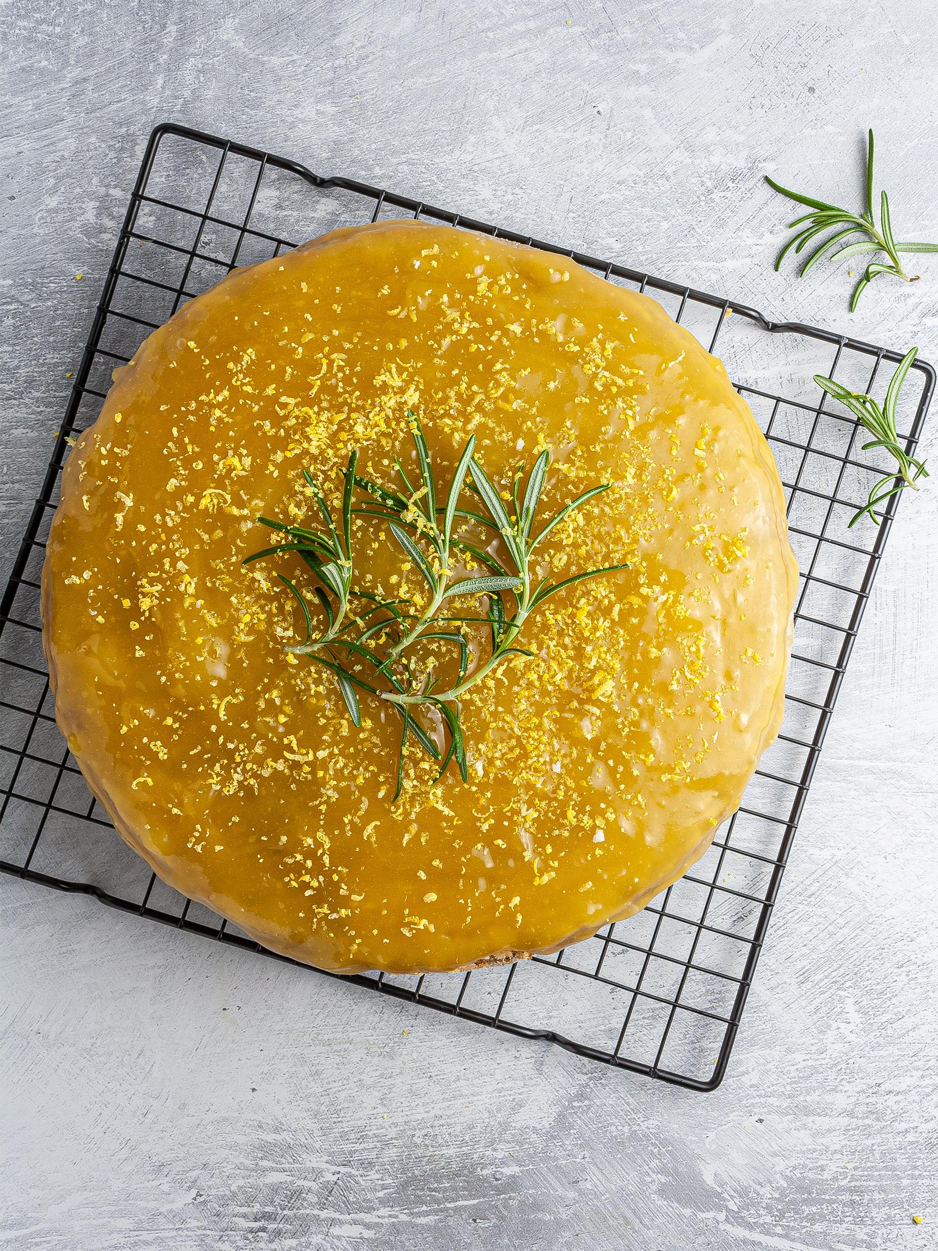 Baked lemon rosemary cake topped with lemon curd