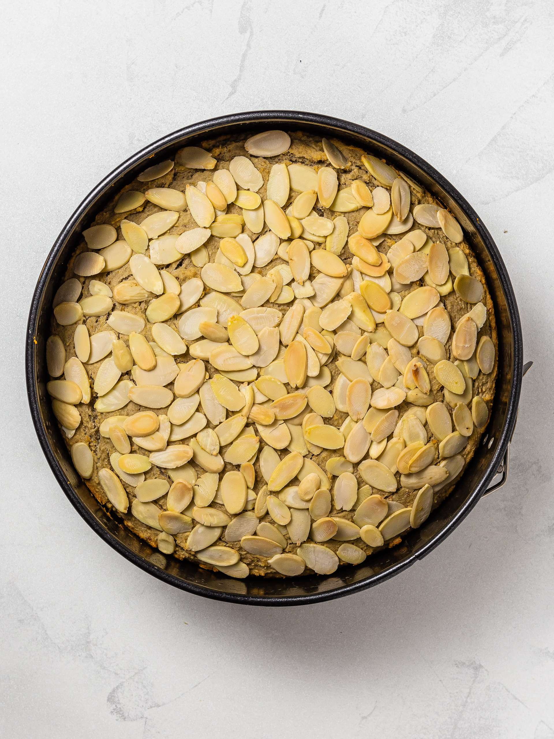 baked gluten-free almond cake in a tin