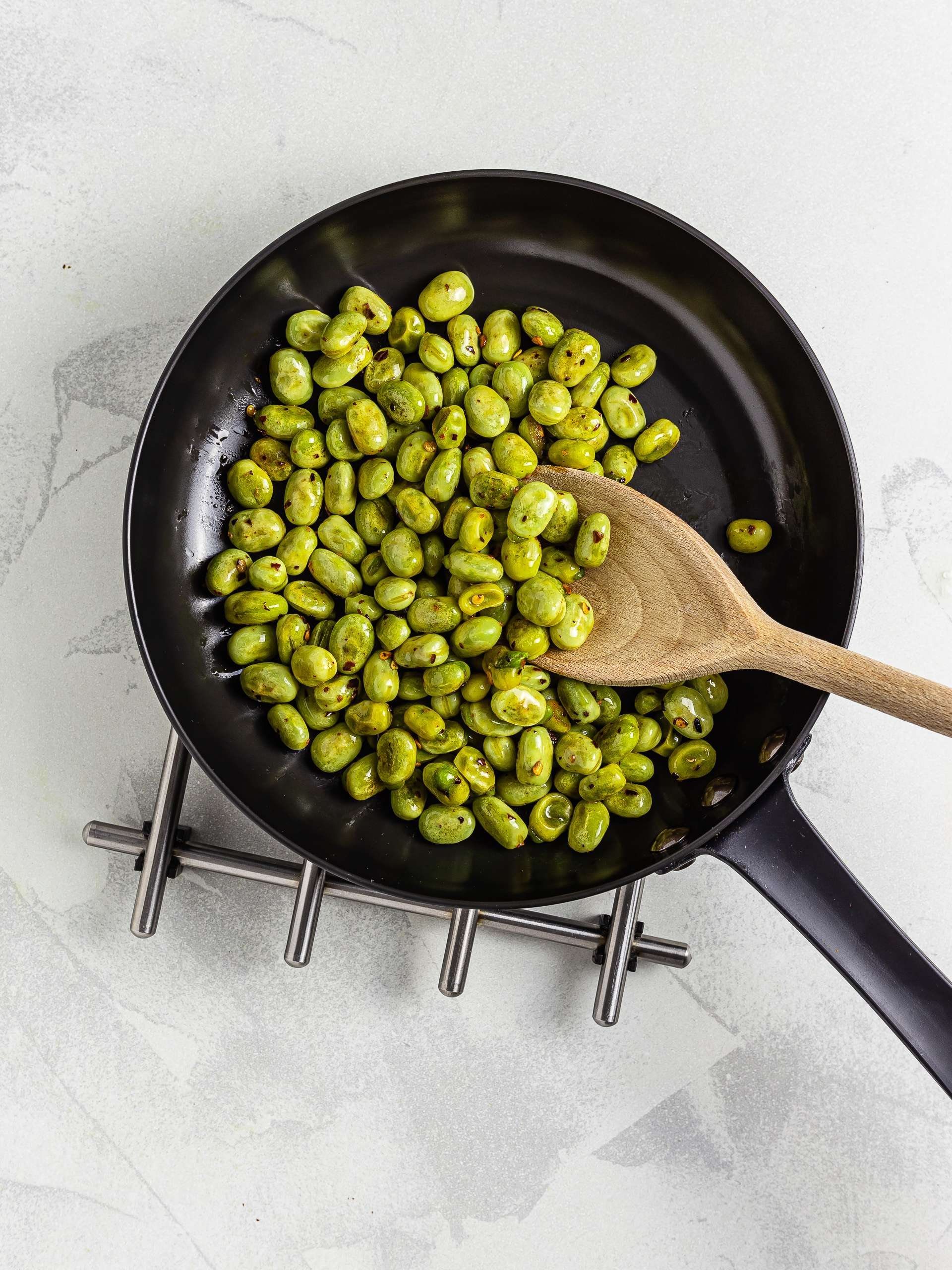 cooked broad beans in a pan