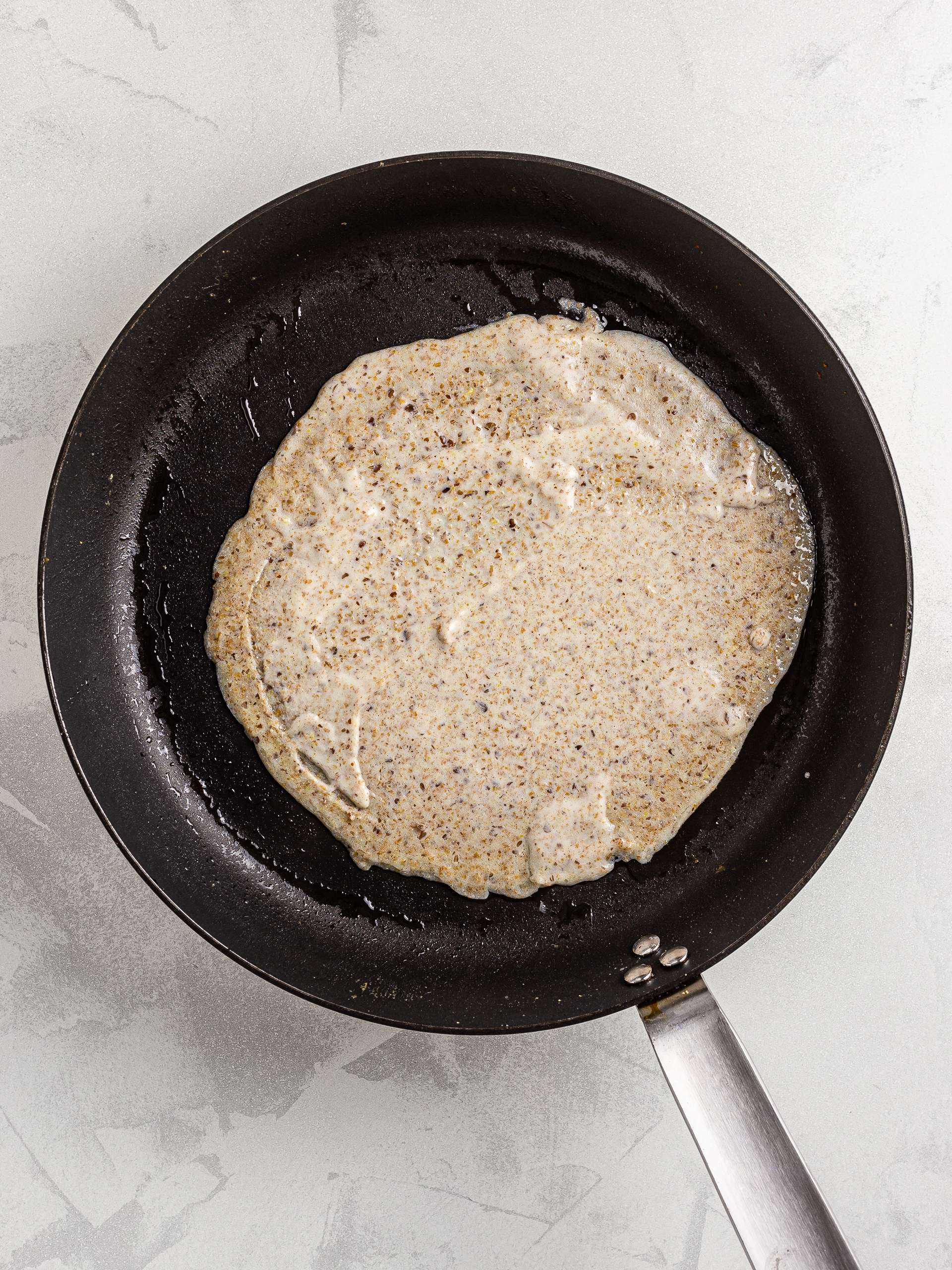 almond milk crepe in a skillet