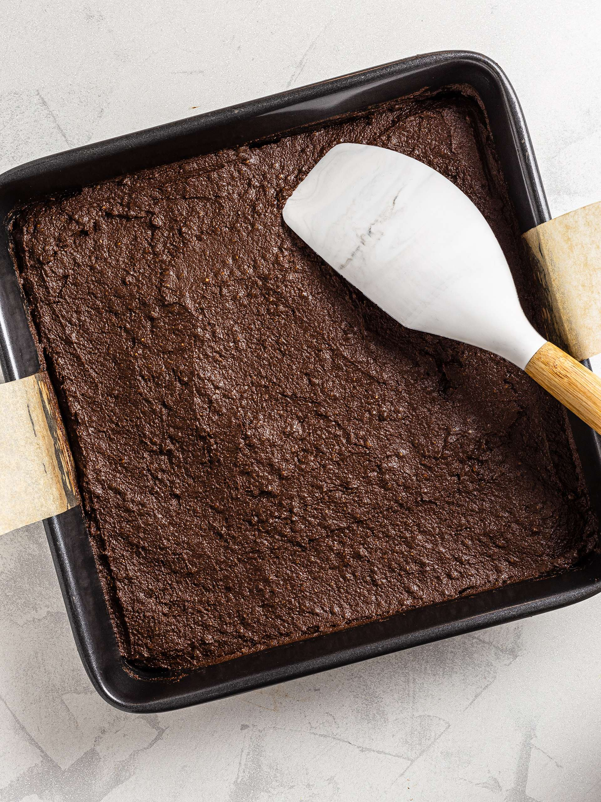 Brownie dough in baking pan