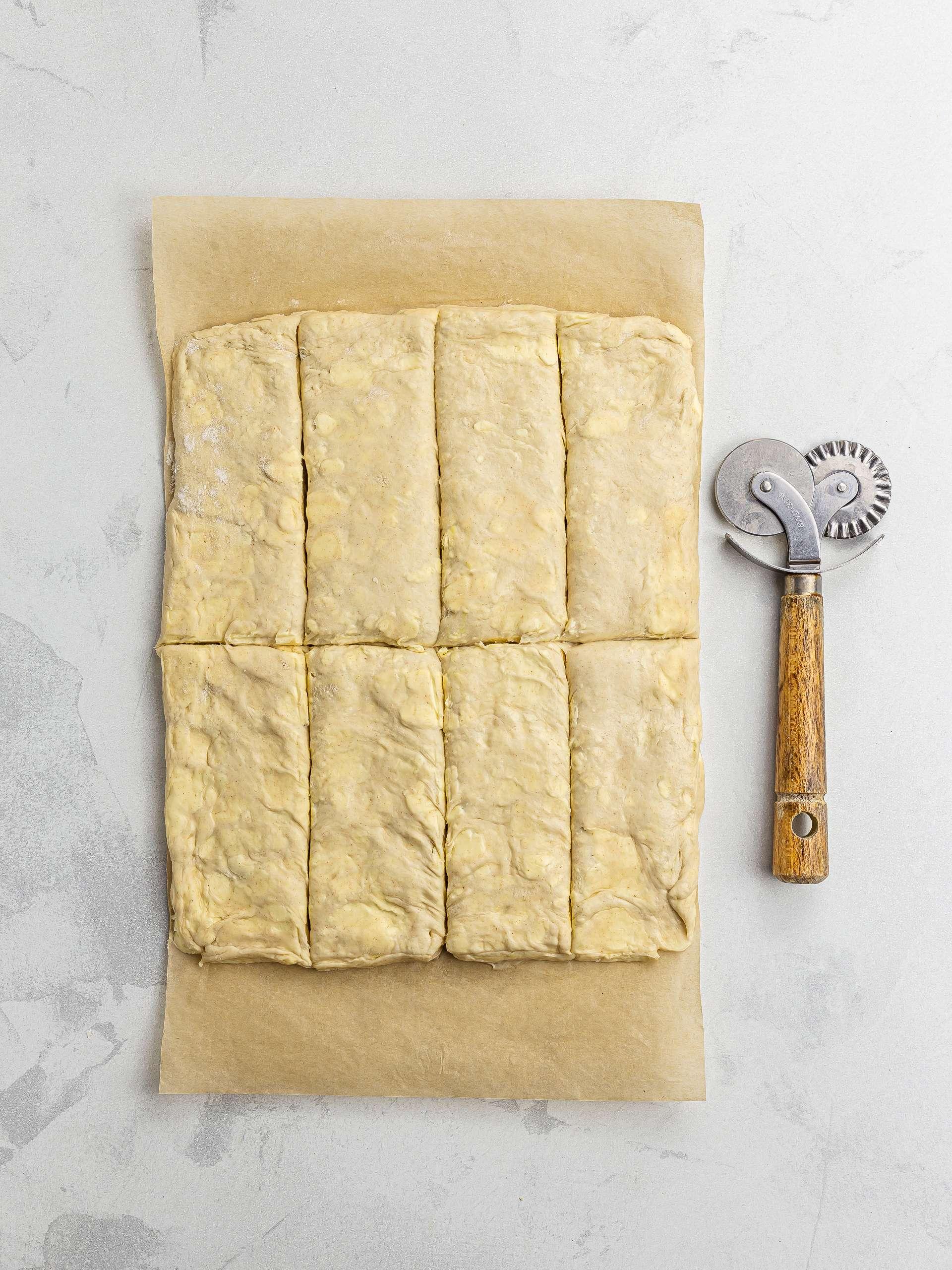 cut out pastry dough for pain au chocolat