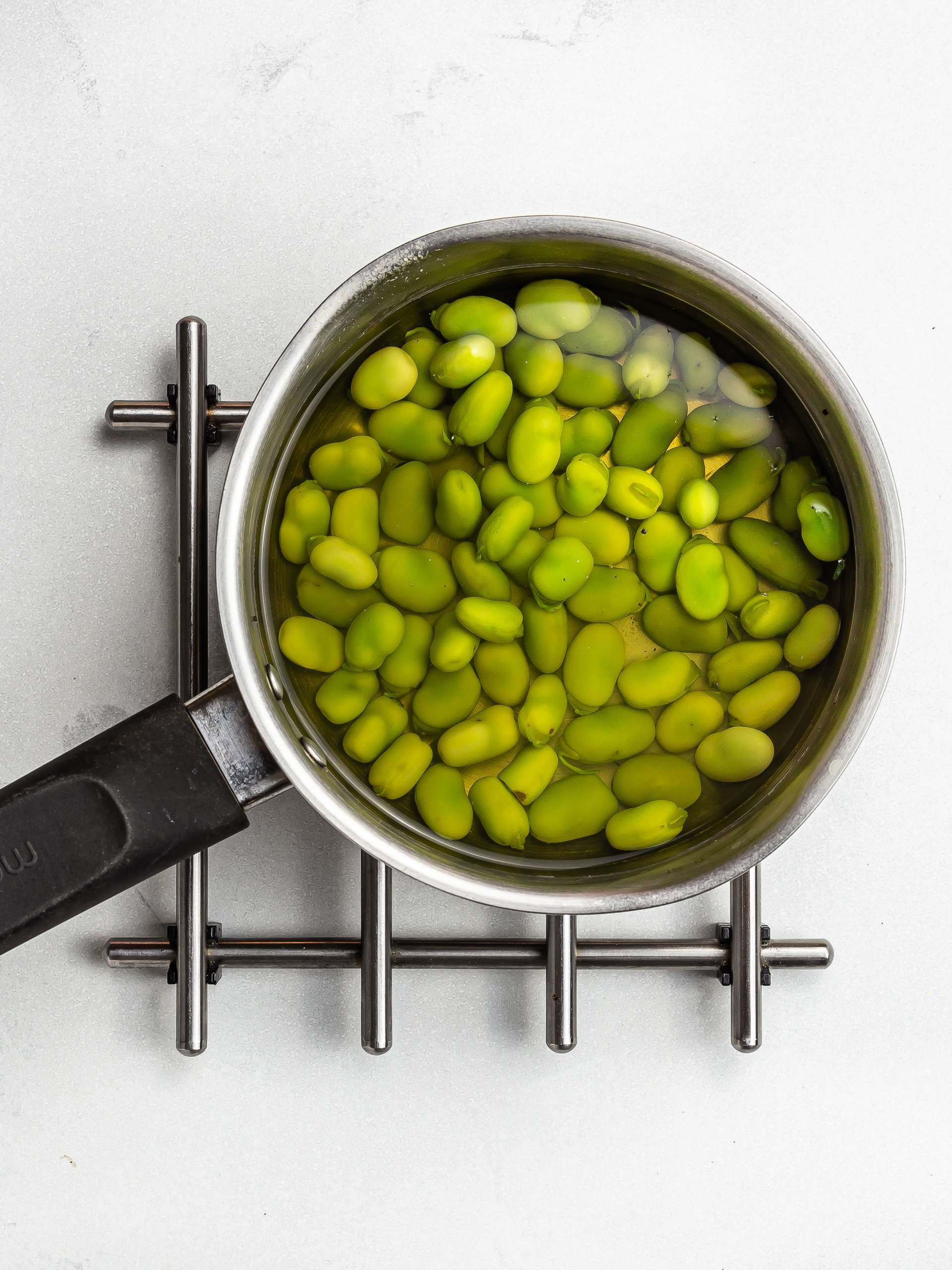 boiled broad beans in a pot